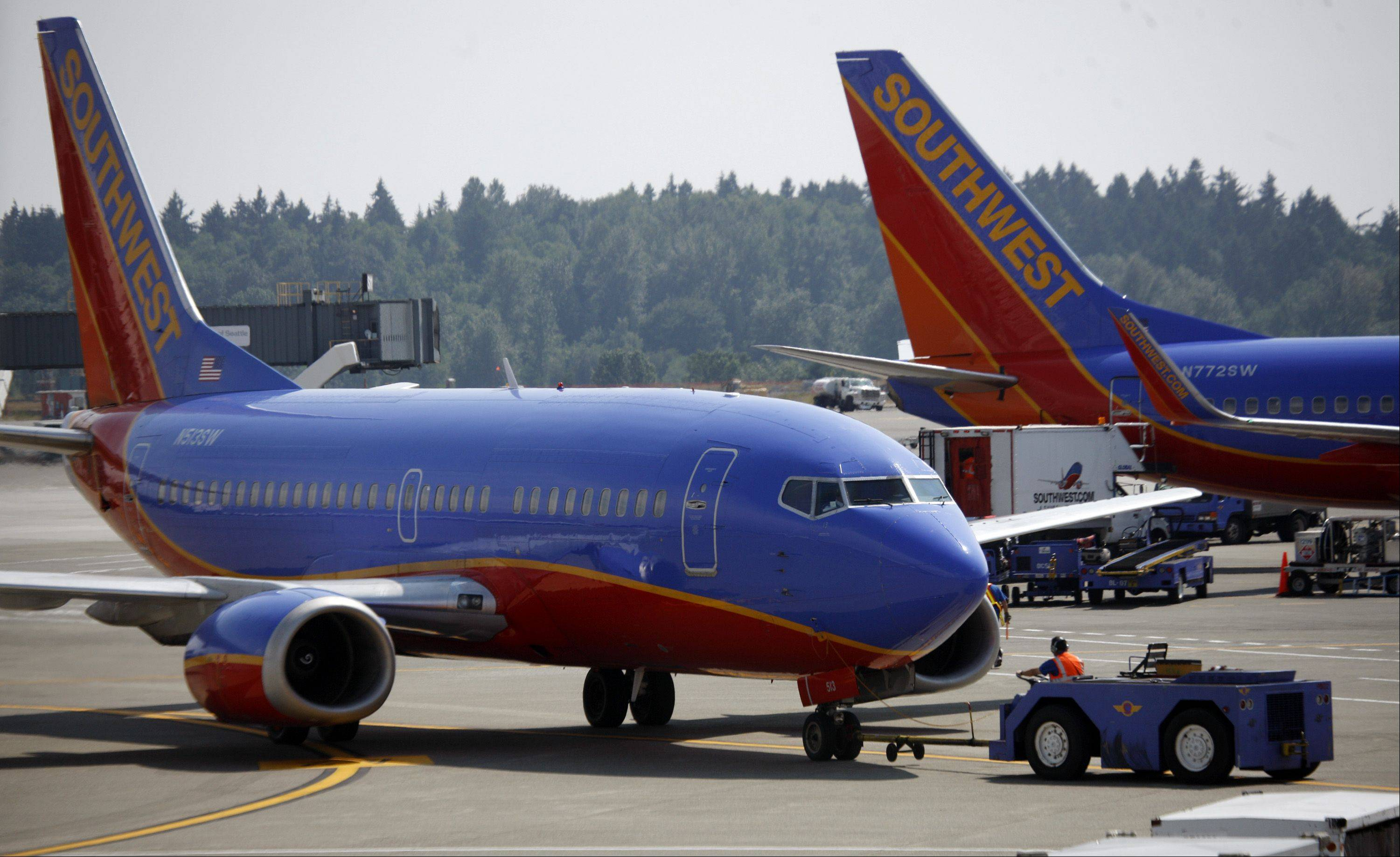 Southwest Airlines eked out a small third-quarter profit in spite of a September slowdown, the company said on Thursday. The airline has been using a mix of fare increases and sales to try to get its prices to a level that travelers will pay. Last month, fares paid by business travelers were soft, CEO Gary Kelly said on CNBC.