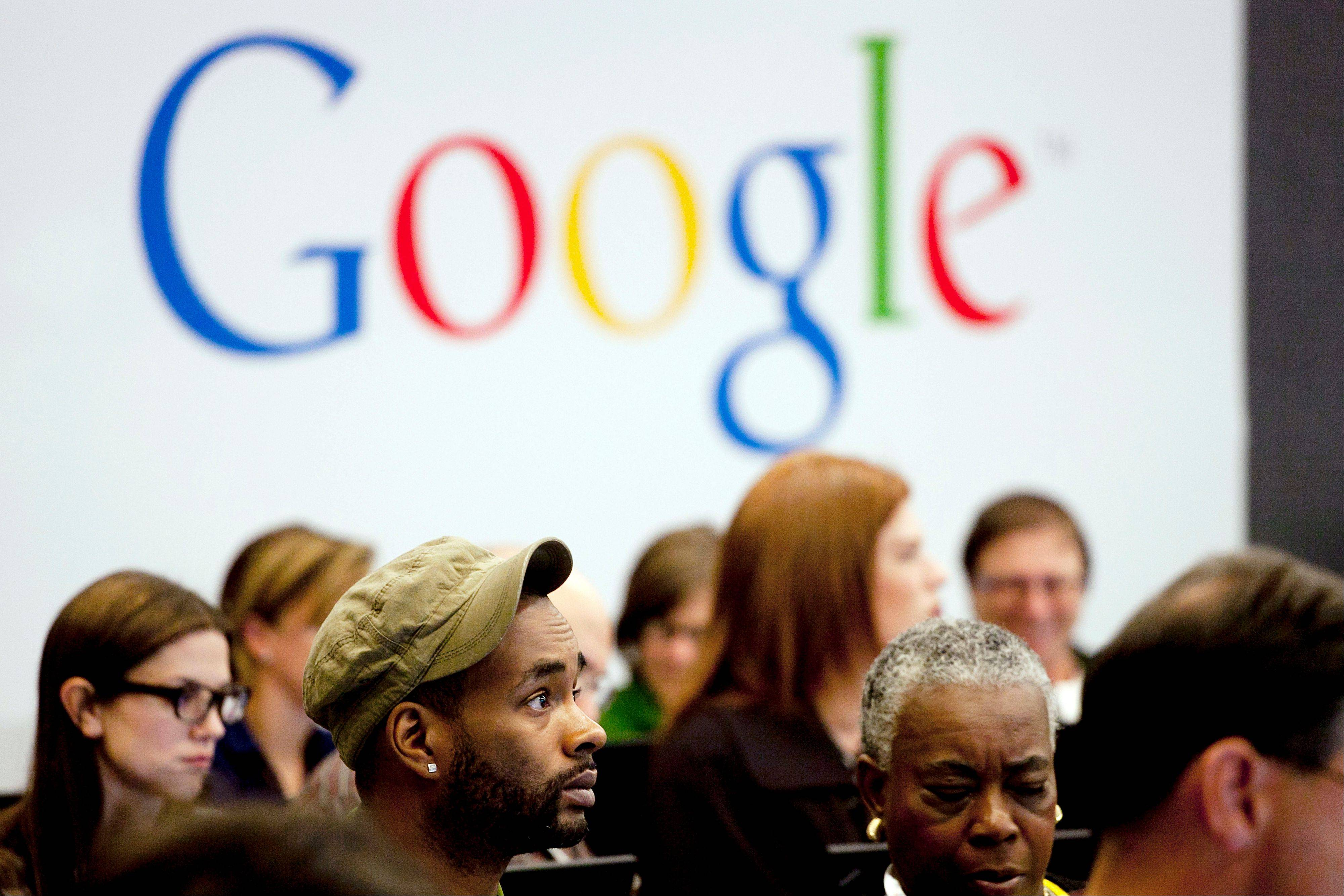 "People attend a workshop, ""New York Get Your Business Online,"" Wednesday at Google offices in New York. Google's stock plunged suddenly Thursday afternoon."