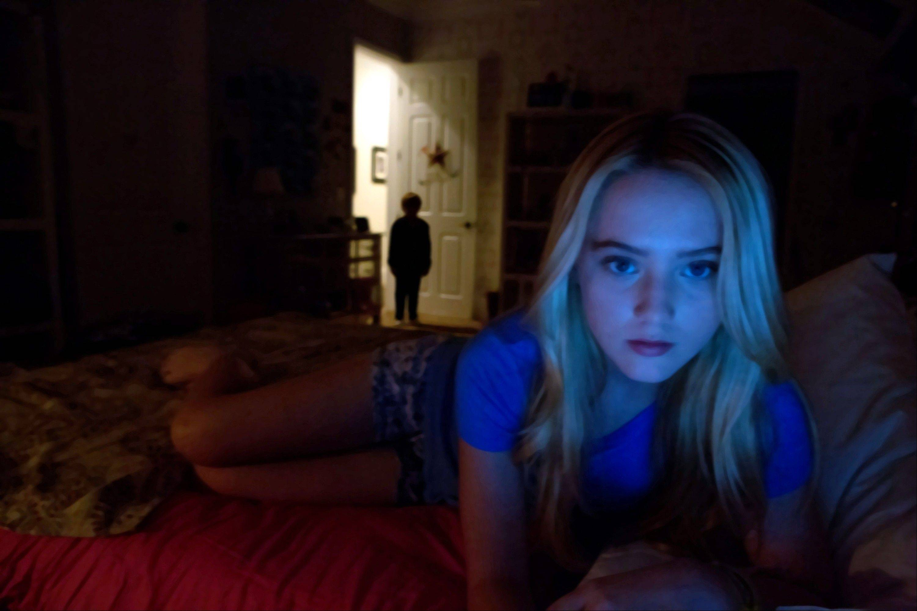 "Alex (Kathryn Newton) notes something amiss when her family takes in a neighbor boy in ""Paranormal Activity 4."""
