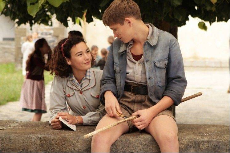 "Violette (Ilona Bachelier) befriends local gang leader Lebrac (Jean Texier) in the too-cute Nazi occupation drama ""War of the Buttons."""