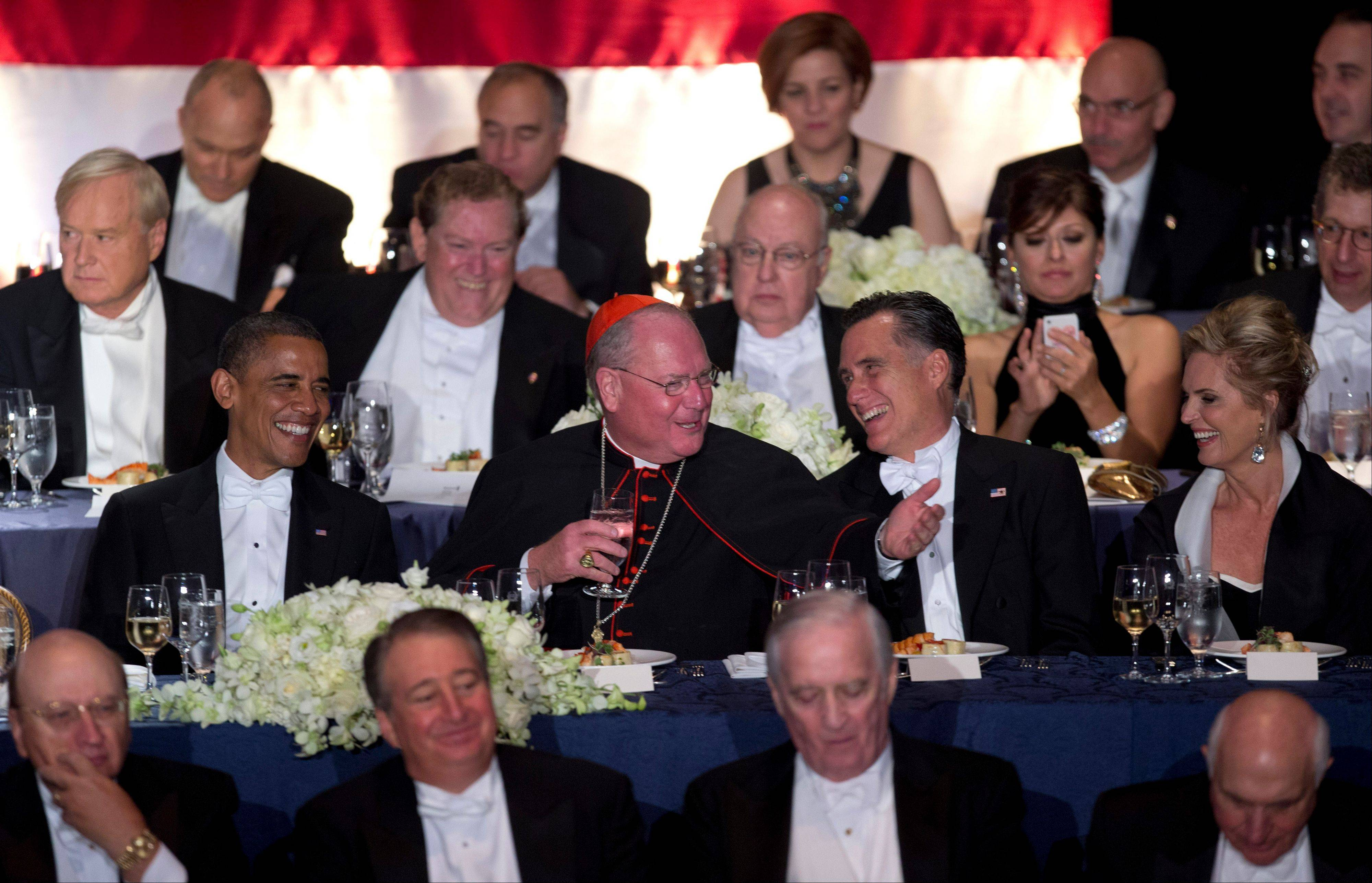 ASSOCIATED PRESSYou might think at first that Cardinal Timothy Dolan was strategically placed between presidential candidates President Barack and former Gov. Mitt Romney as a peacekeeper. But the 67th annual Alfred. E. Smith Memorial Foundation Dinner Thursday in New York has been campaign tradition where comic relief prevails. That's Ann Romney, the governor's wife, at the far right.