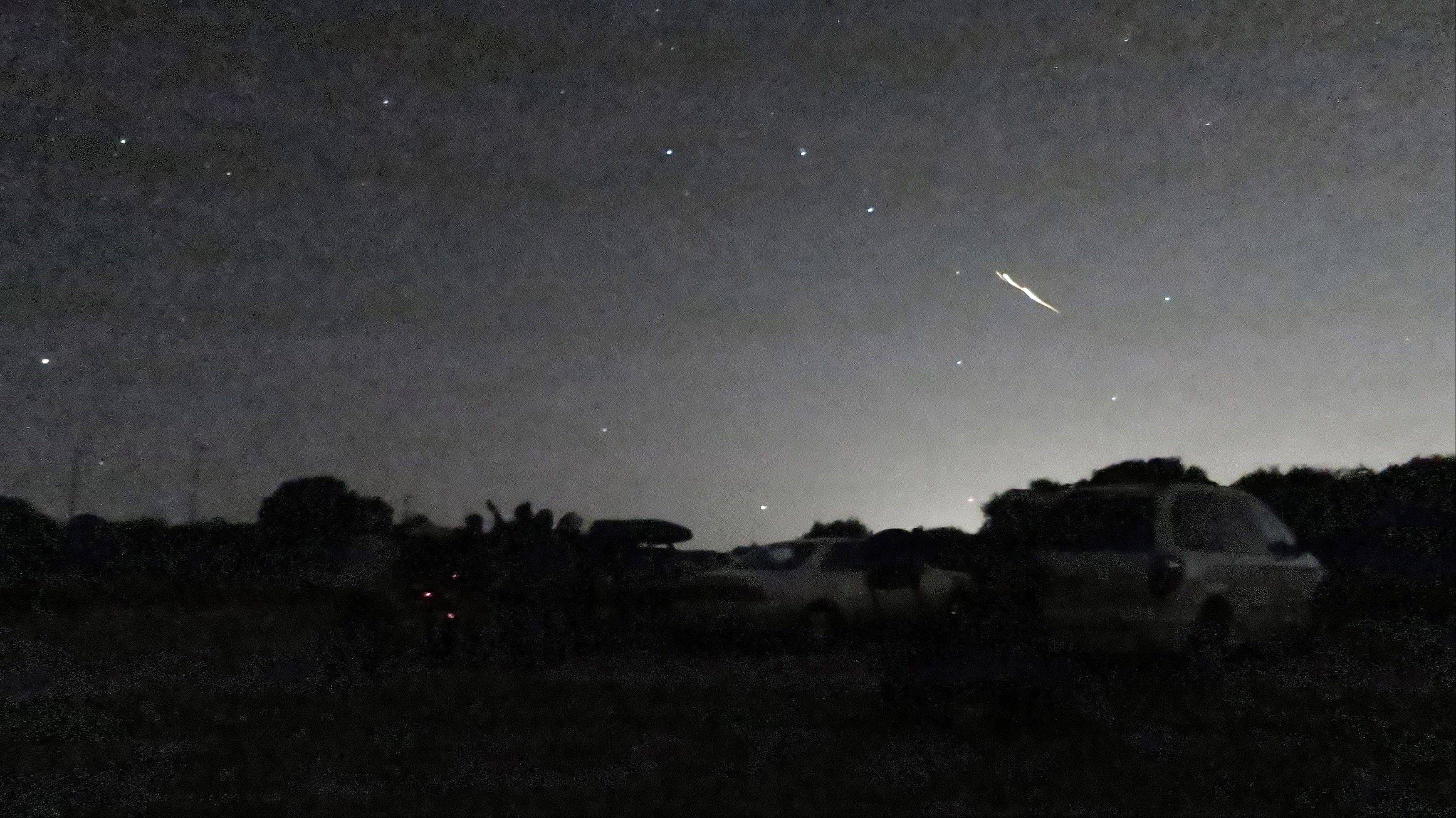 A shooting star is seen above the Montebello Open Space Preserve in Palo Alto, Calif. Streaking fireballs lighting up California skies and stunning stargazers are part of a major meteor shower, and the show is just getting started, professional observers said.