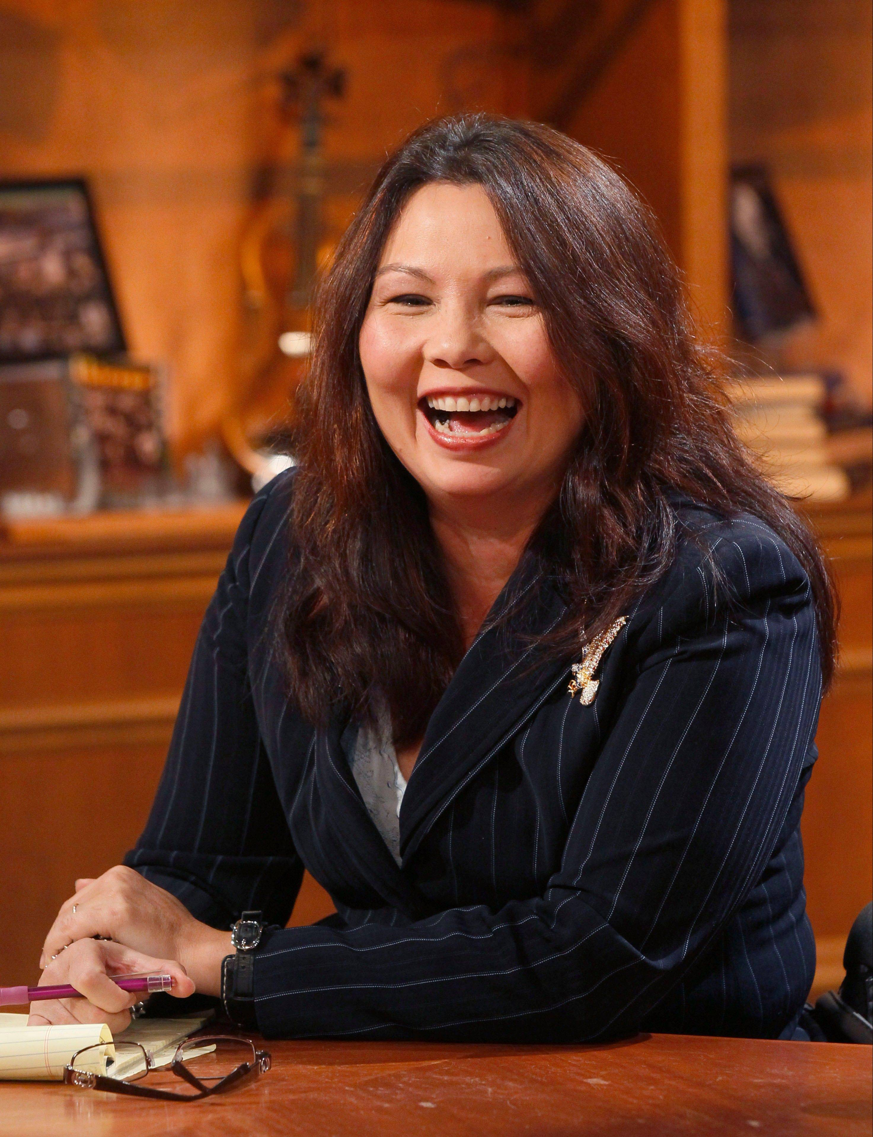 Democratic challenger Tammy Duckworth waits for the start of a televised debate against U.S. Rep. Joe Walsh at the WTTW studios Thursday in Chicago.