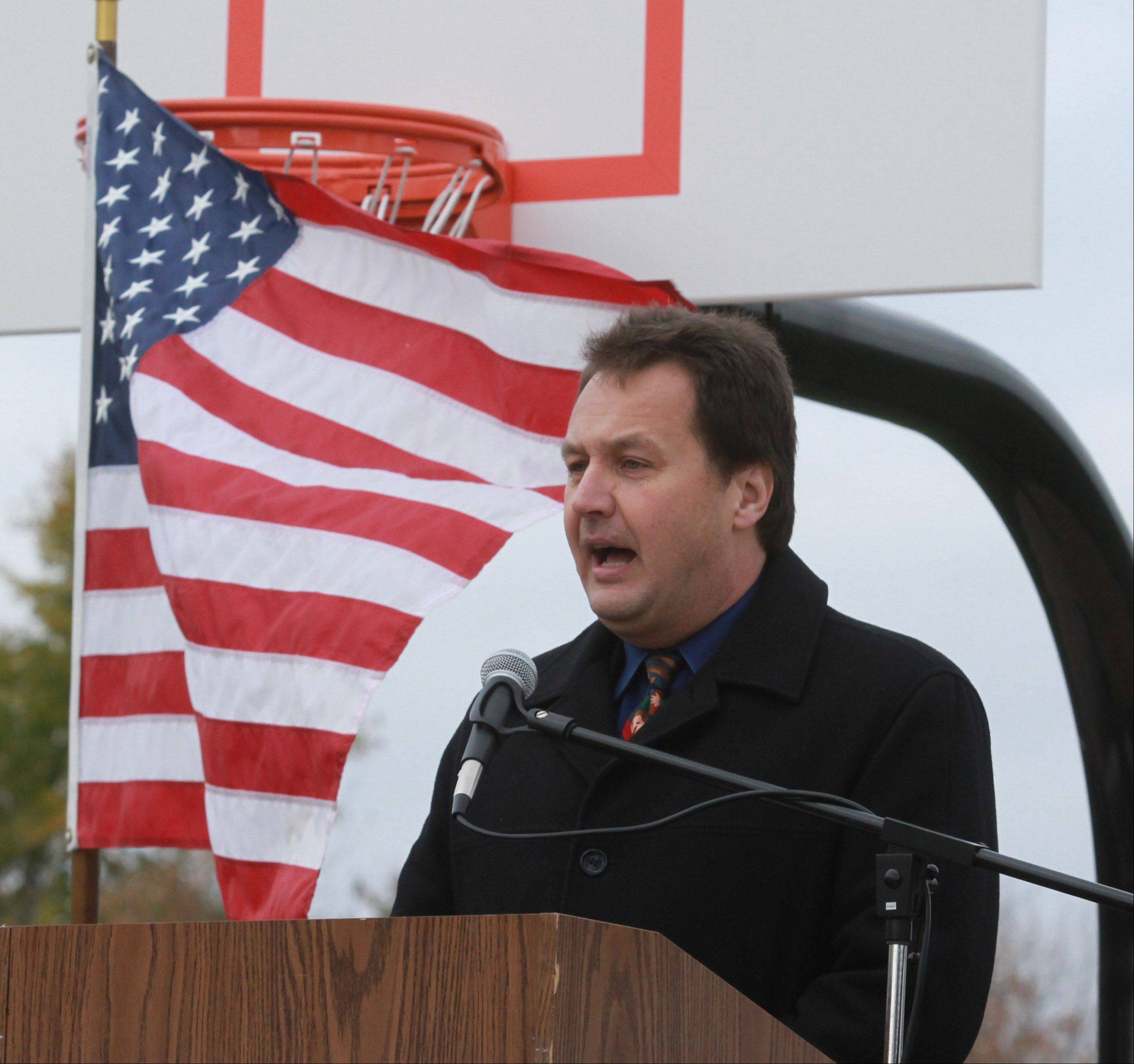 Quest Academy's Head of School Benjamin Hebebrand speaks during the school's ribbon-cutting ceremony for its 3.68-acre outdoor West Campus in Palatine on Thursday.
