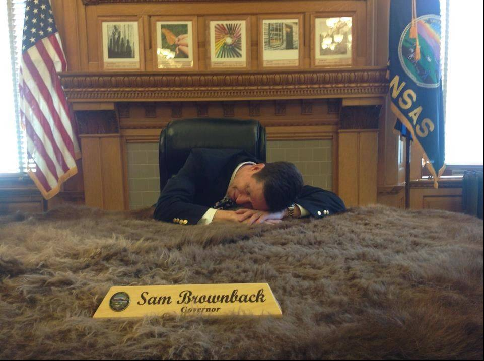 Pretending to take a nap on a buffalo hide in the office of Kansas Gov. Sam Brownback, Mickey Straub managed to have fun during his pilgrimage to bring Abe Lincoln's message to all 50 states.