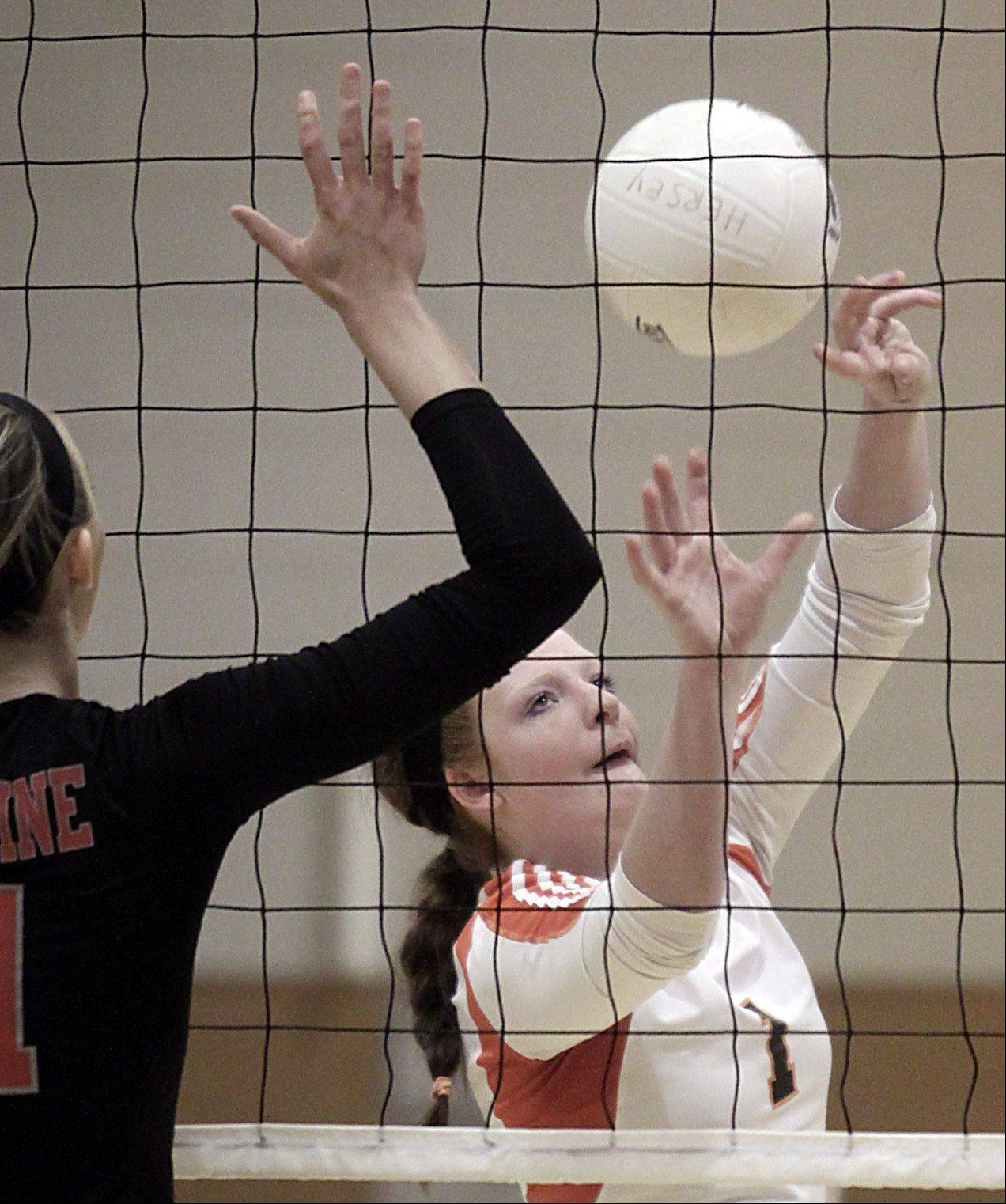 Hersey's Abby Fesl prepares to set the ball against Palatine during the Mid-Suburban League championship volleyball game in Arlington Heights on Thursday night.