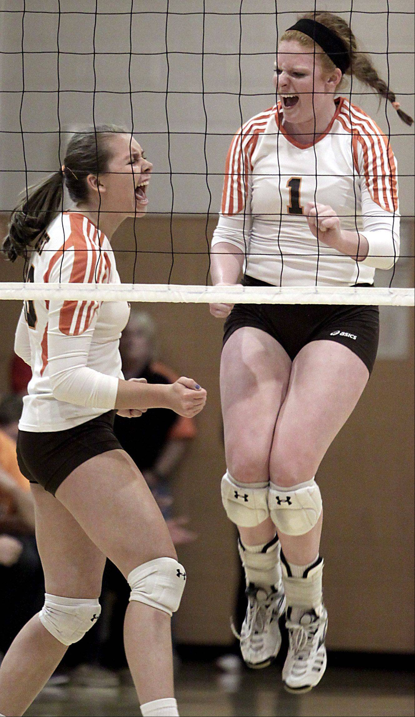 Hersey's Abby Fesl, right, celebrates with teammate Liz Fuerst after a point against Palatine during the Mid-Suburban League championship volleyball game in Arlington Heights on Thursday night.