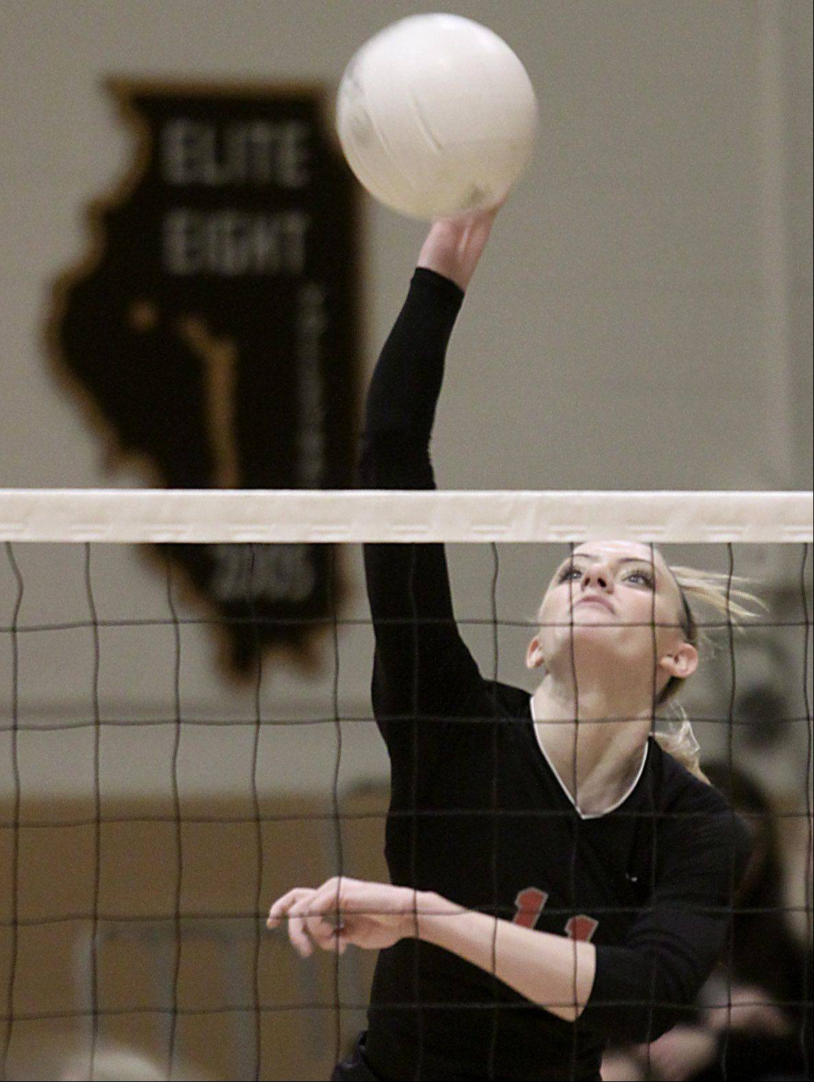 Palatine's Taylor Fricano plays against Hersey during the Mid Suburban League championship volleyball game in Arlington Heights on Thursday night.