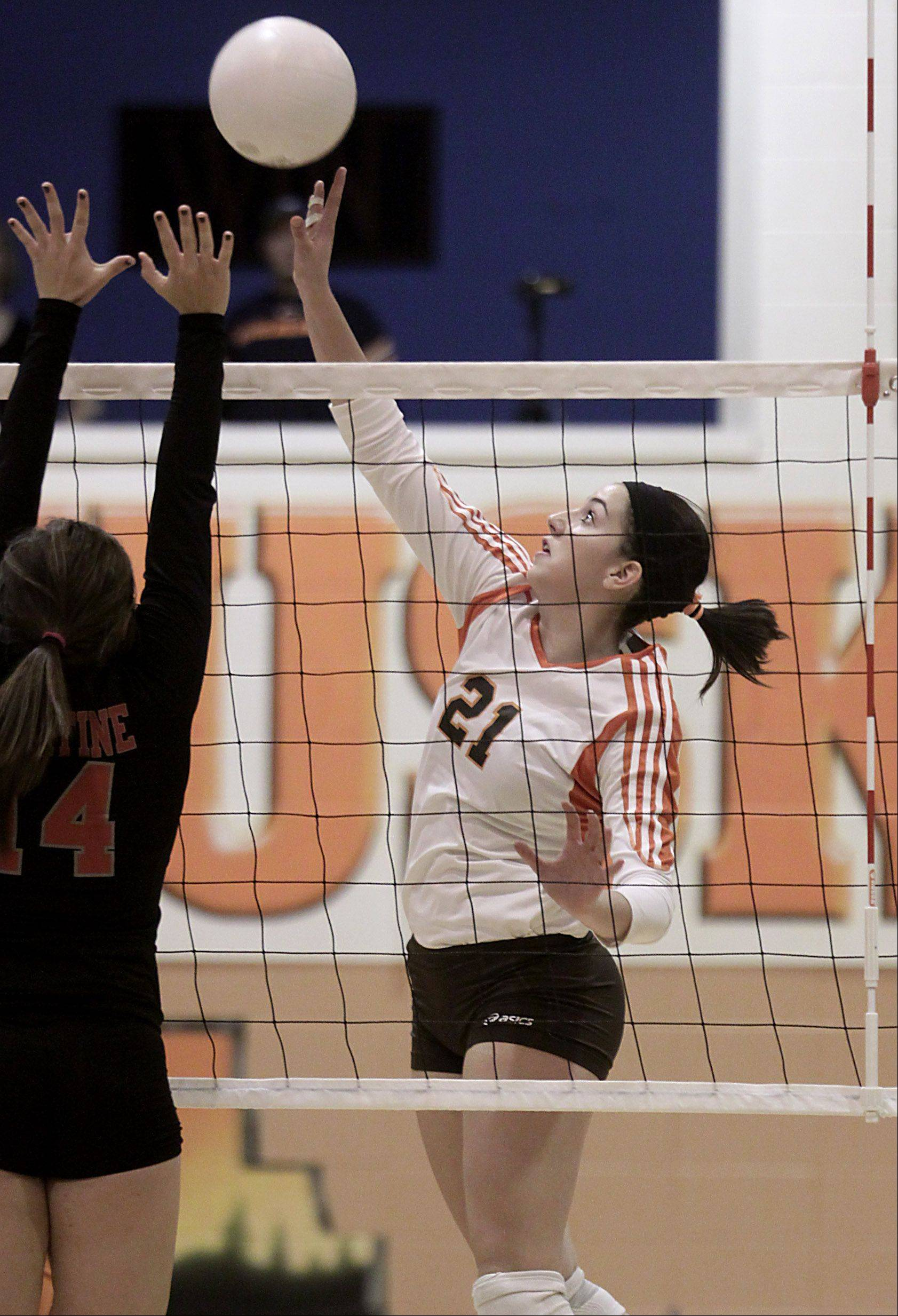 Hersey's Courtney Stedman hits the ball against Palatine during the Mid-Suburban League championship volleyball game in Arlington Heights on Thursday night.