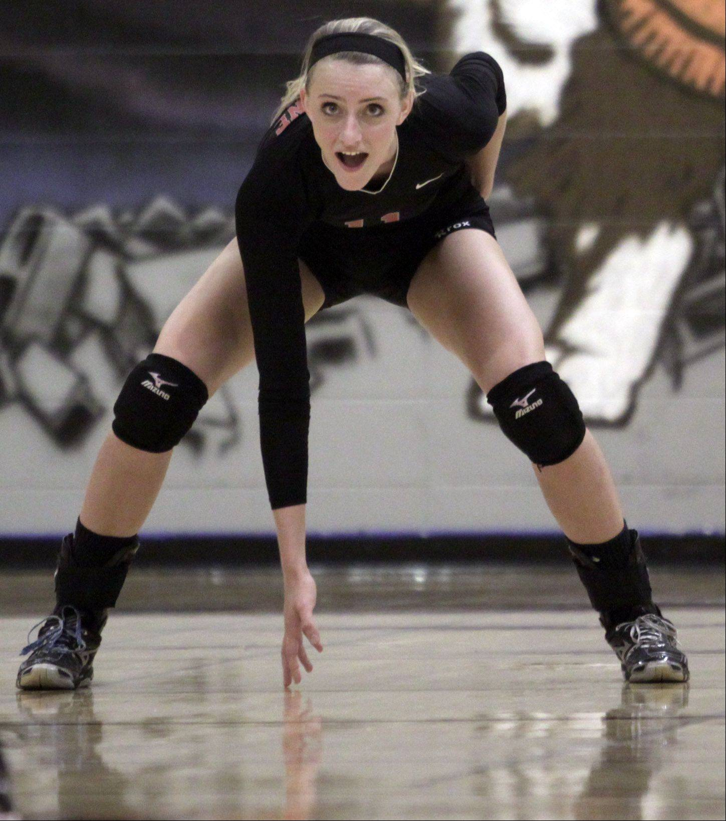 Palatine's Taylor Fricano plays against Hersey during the Mid-Suburban League championship volleyball game in Arlington Heights on Thursday night.