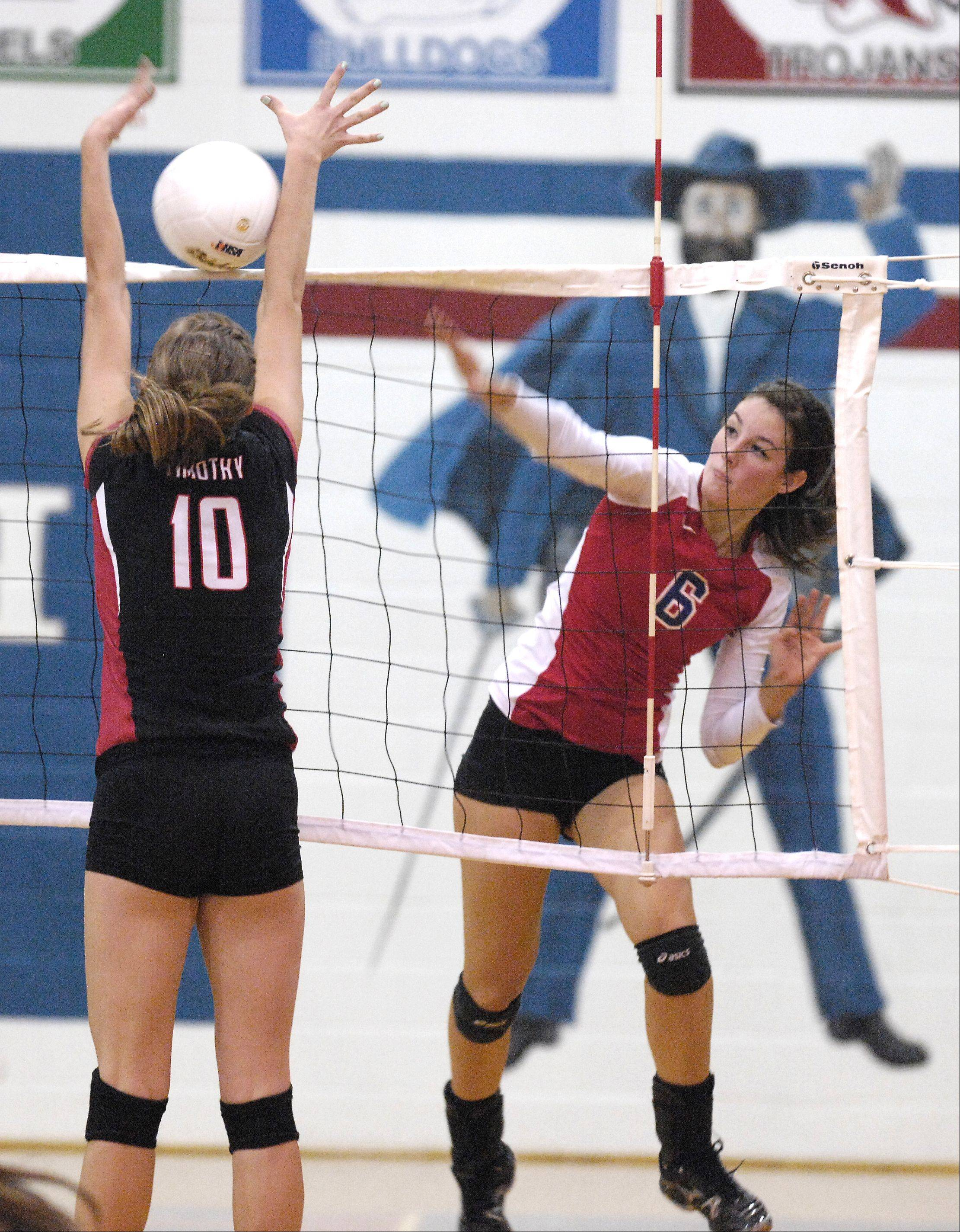 Jena Lodewyk of Timothy Christian goes up to block a shot by Tarah Valdez of Glenbard South during the Raiders 2-0 win over the Trojans during girls volleyball in Glen Ellyn, Thursday.