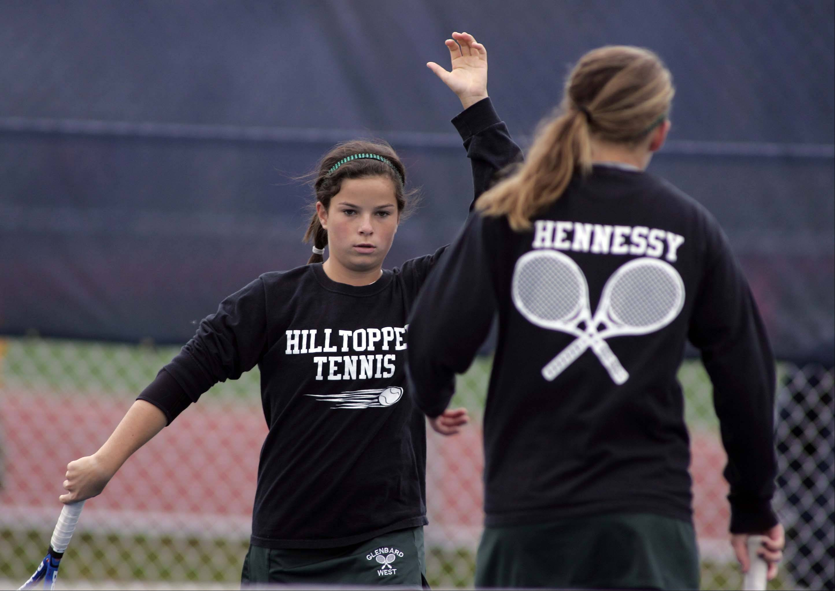 Glenbard West's Molly Hennessy, right, & Ali Bush, in their match against Carmel during the IHSA girls state tennis finals at Buffalo Grove High School Thursday October 18, 2012.
