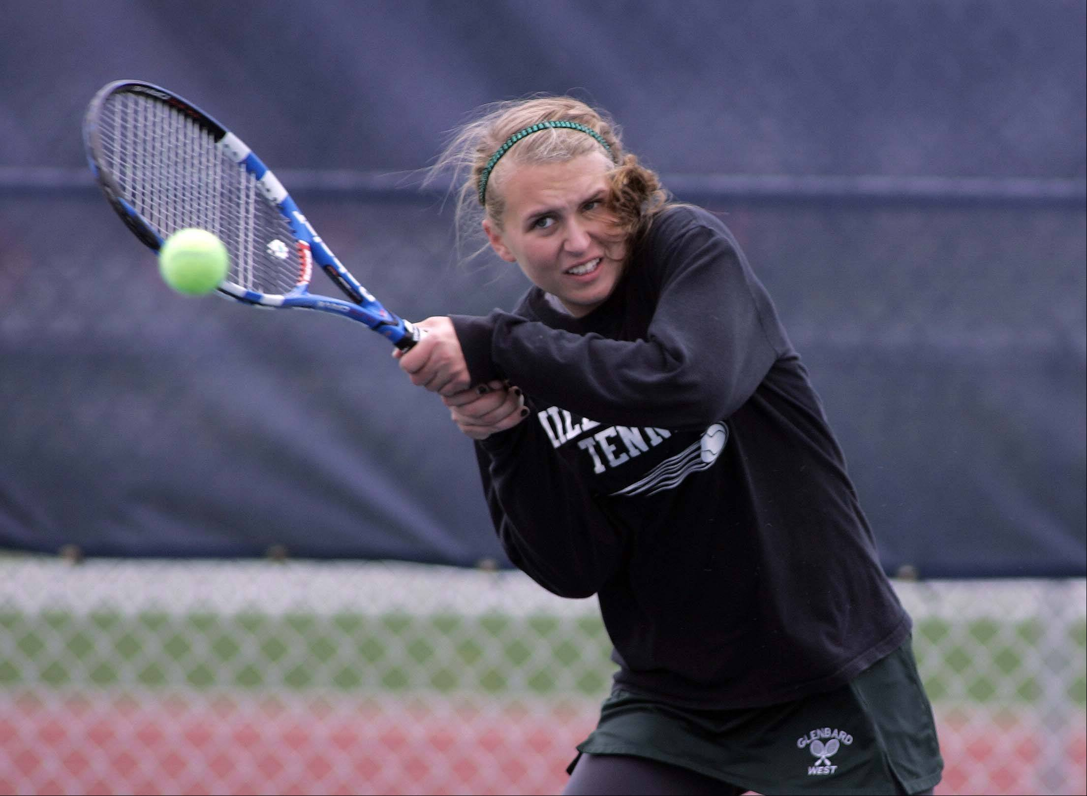 Glenbard West's Molly Hennessy in their doubles match against Carmel during the IHSA girls state tennis finals at Buffalo Grove High School Thursday October 18, 2012.