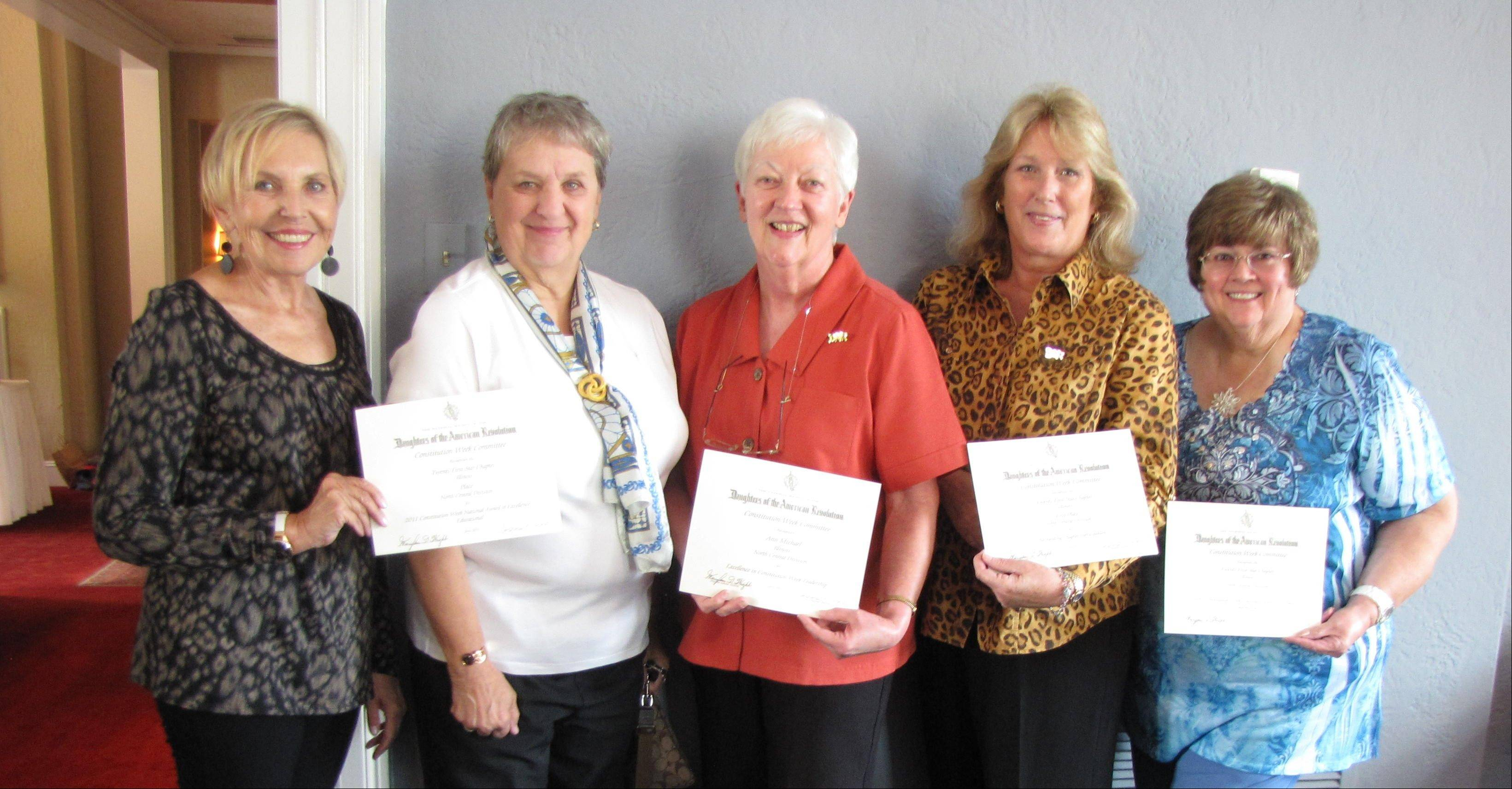 The 2011-12 Constitution Week Committee Jill Muck, Jeanette Frye, Ann Michael, Carol Gale and Barbara Hale, with the regional and national award certificates. Not pictured is Rhonda Lang.