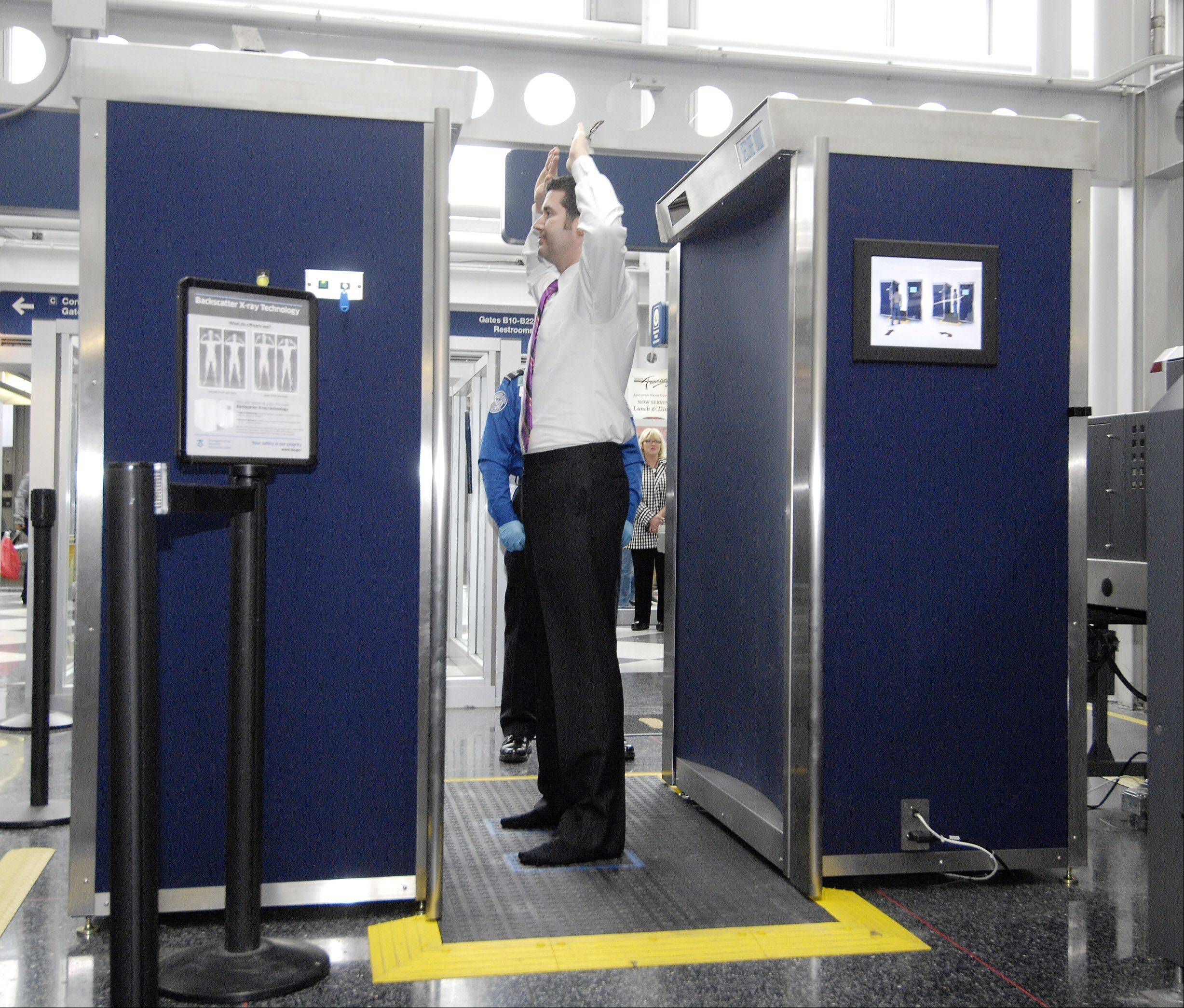 Twenty-three full-body X-ray scanners are being removed from O'Hare International Airport to make room for scanners that can move more passengers through security.