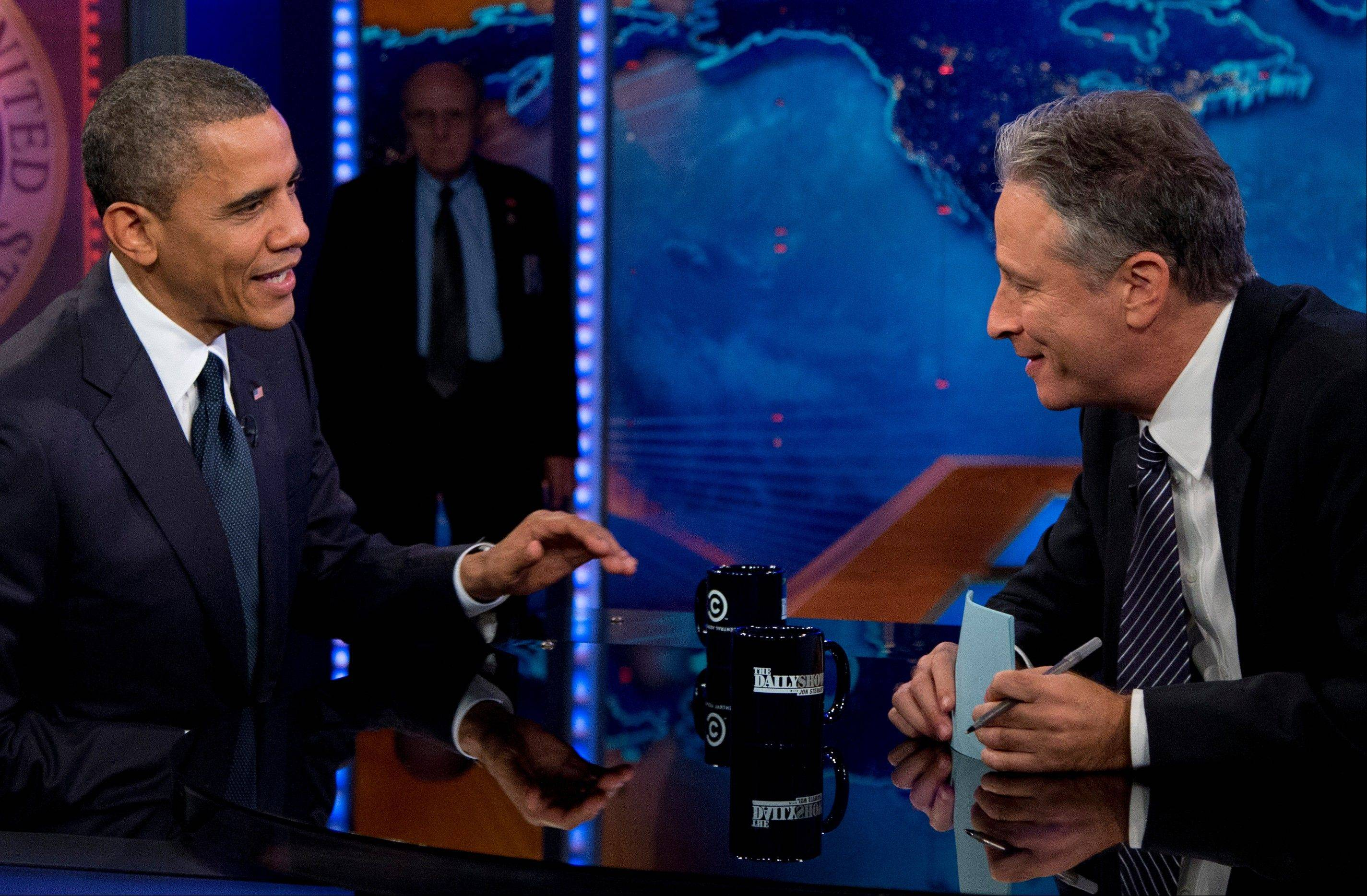 President Barack Obama talks with Jon Stewart during a taping of his appearance on �The Daily Show with John Stewart�, Thursday, Oct. 18, 2012, in New York.