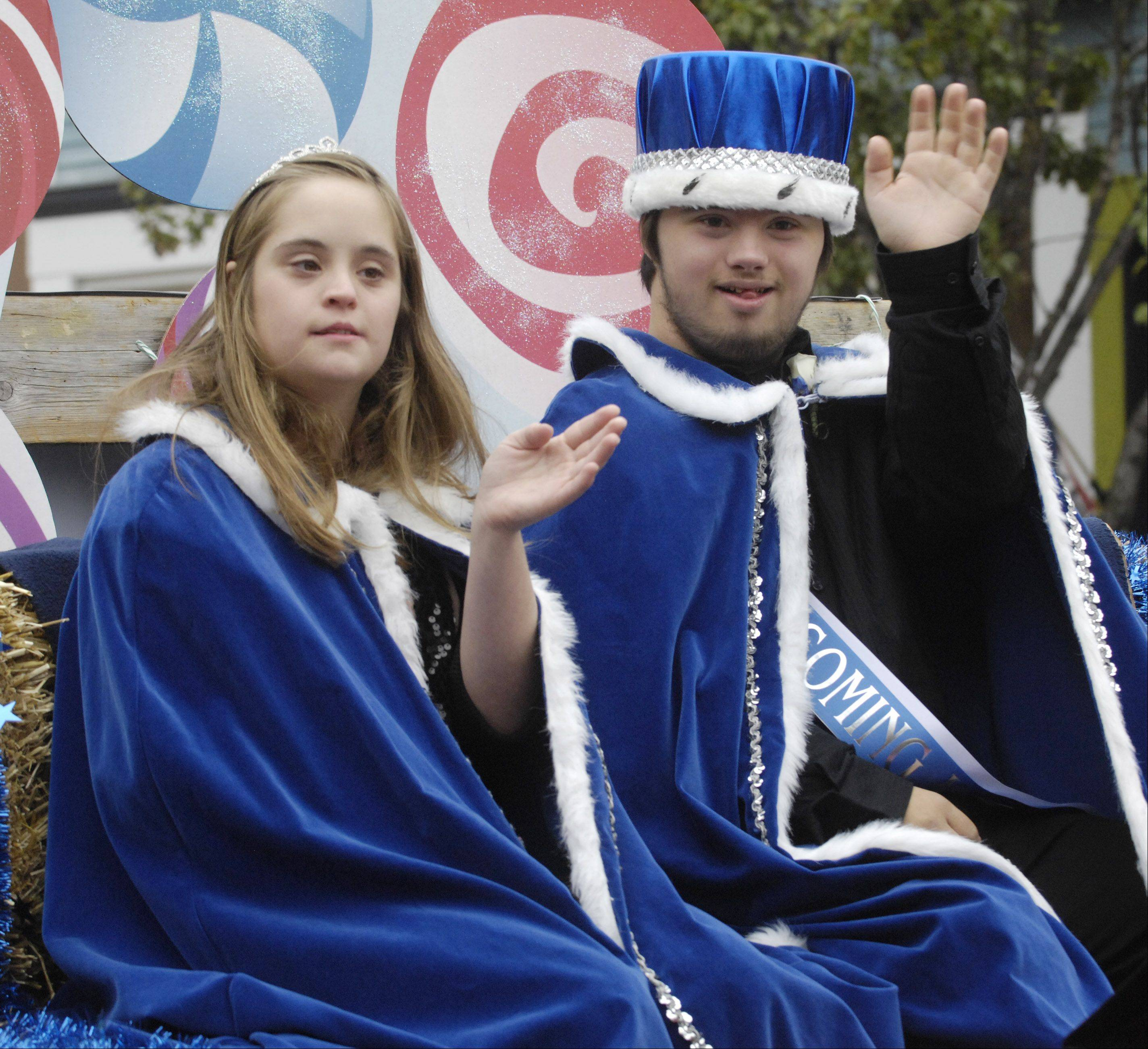 Homecoming queen Krissy Altersohn and king Thomas Broviak ride on a float during Geneva High School's homecoming parade.