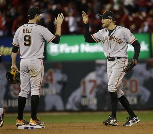 San Francisco Giants' Hunter Pence and Brandon Belt (9) celebrate after Game 5 of baseball's National League championship series against the St. Louis Cardinals Friday, Oct. 19, 2012, in St. Louis. The Giants won 5-0 and trail in the series 3-2.