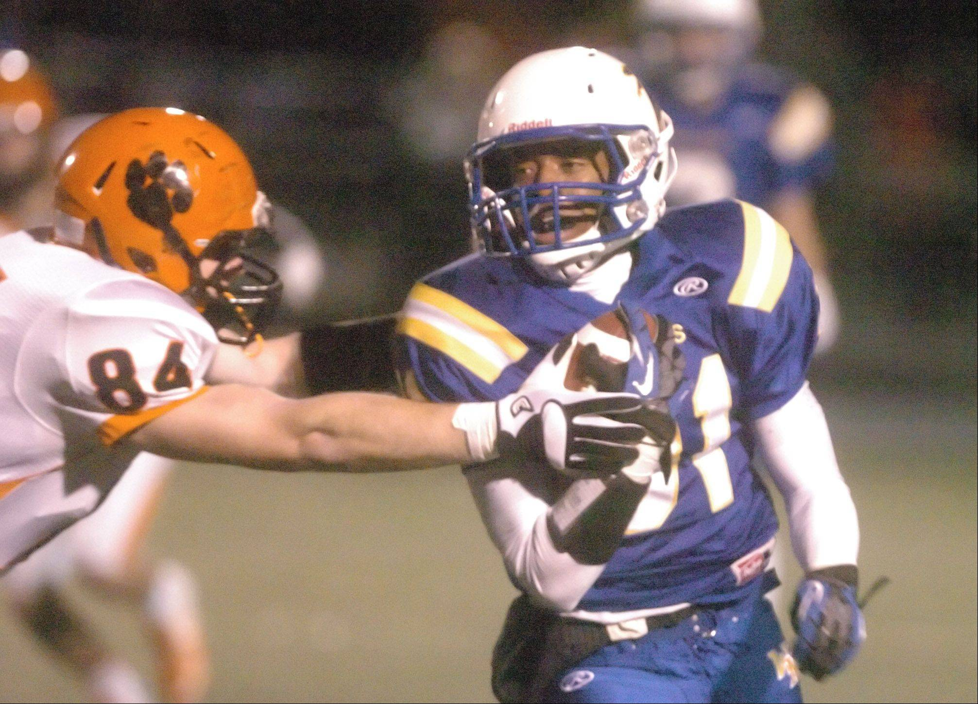 Brian Welch of Wheaton Warrenville South tries to stop Jaylen Howze of Wheaton North.