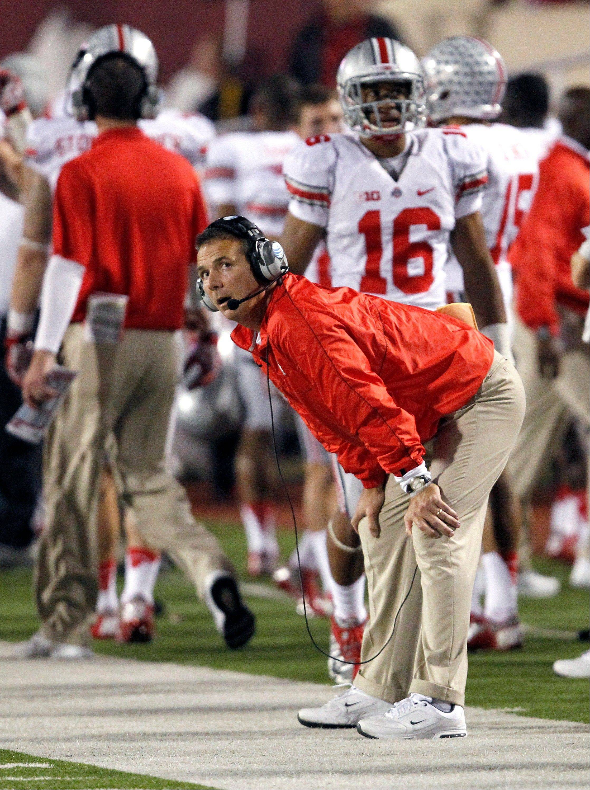 Ohio State coach Urban Meyer checks the replay board late in last Saturday�s game against Indiana in Bloomington, Ind. Ohio State won 52-49.