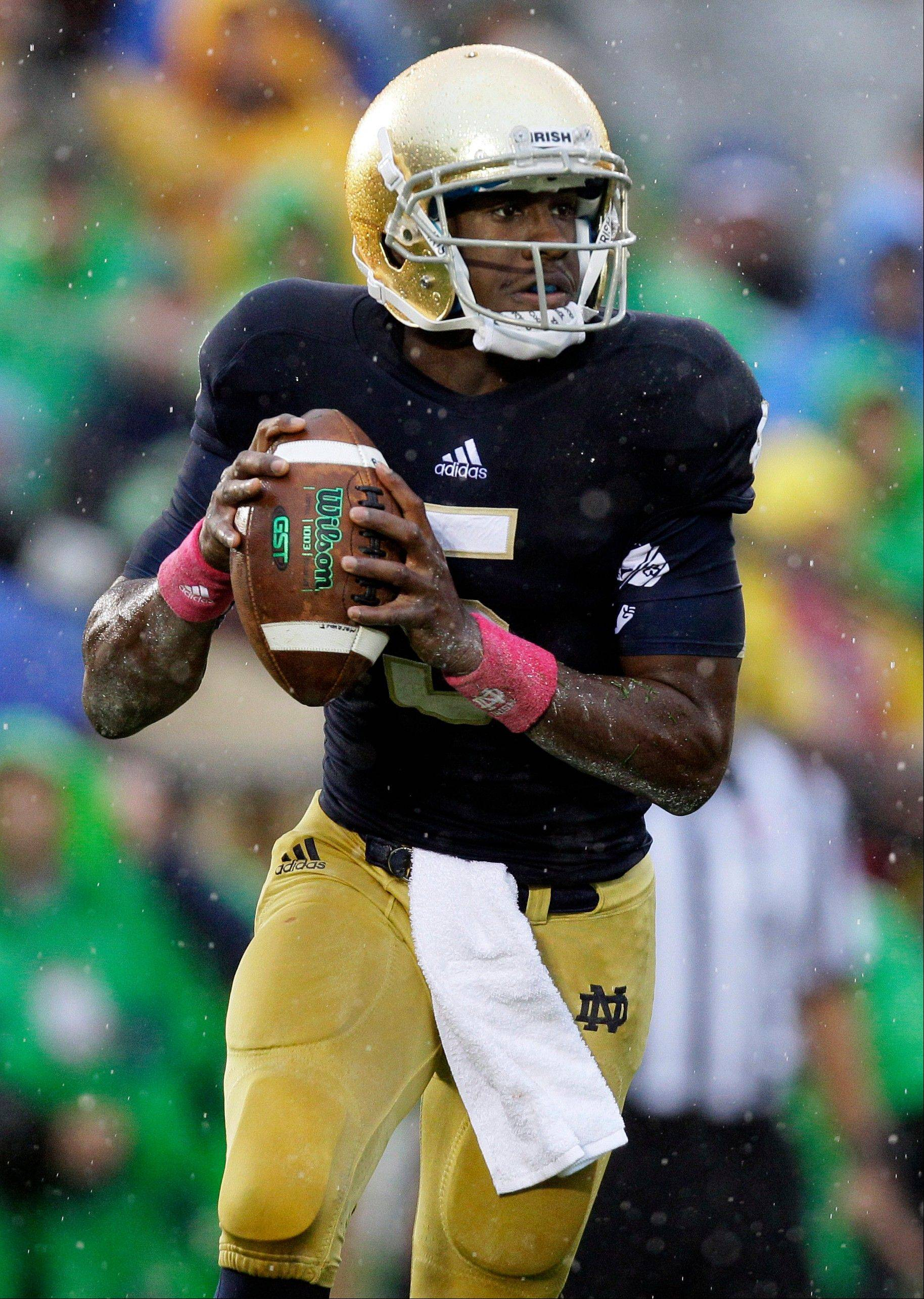 Notre Dame quarterback Everett Golson rolls out to pass during the first half last Saturday�s game against Stanford in South Bend, Ind. Golson sustained a concussion on a helmet-to-helmet hit but has been cleared to play this week. Whether he will is still uncertain.