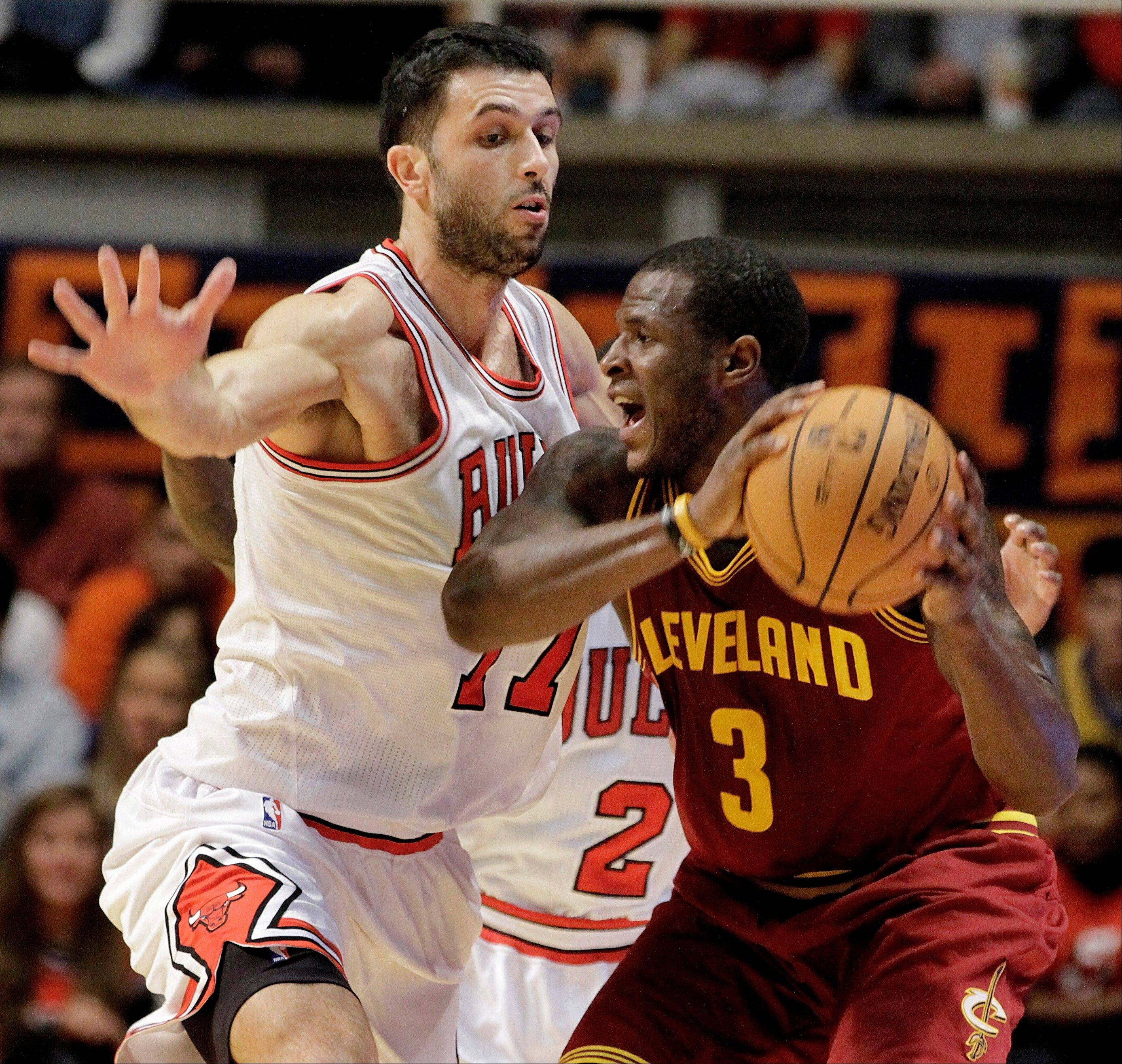 Cleveland Cavaliers guard Dion Waiters goes against Bulls forward Vladimir Radmanovic during preseason action.