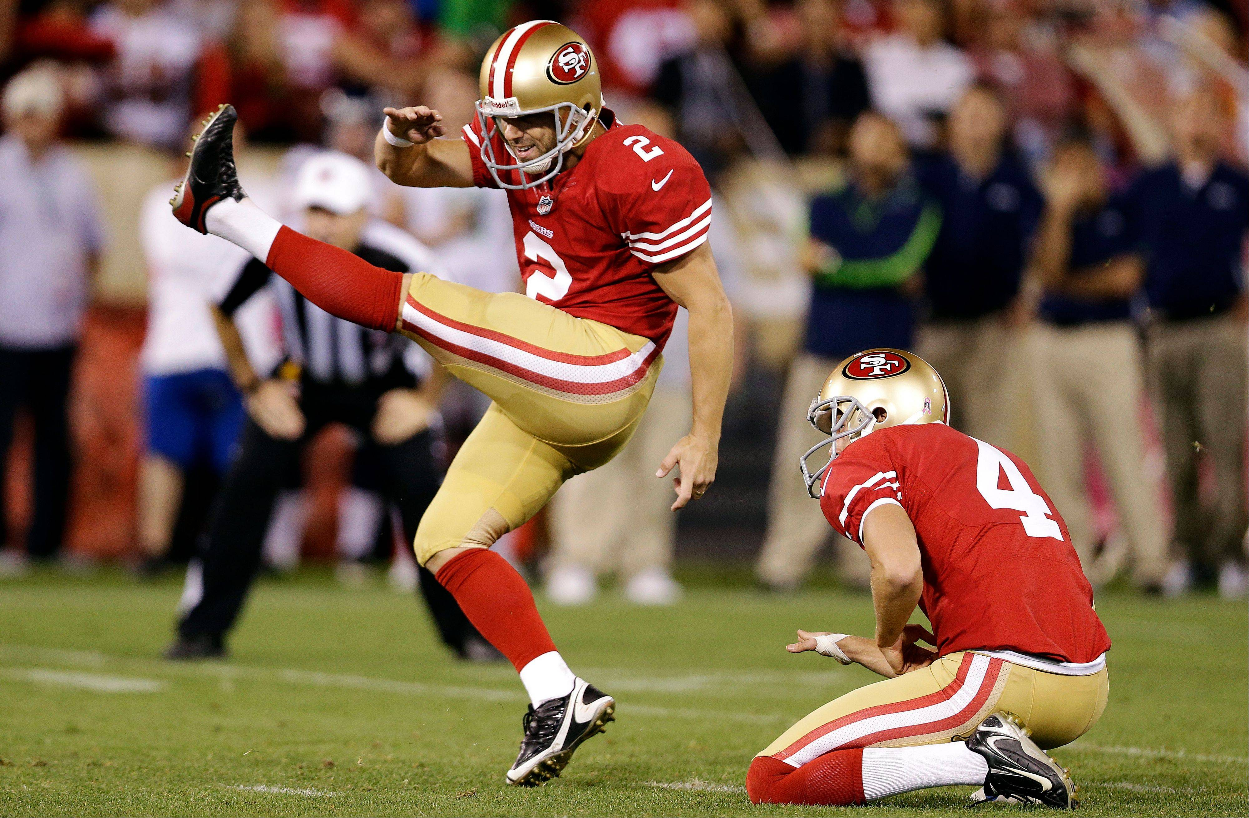 San Francisco 49ers place kicker David Akers (2) makes a field goal as punter Andy Lee (4) holds during the fourth quarter of an NFL football game against the Seattle Seahawks in San Francisco, Thursday, Oct. 18, 2012. The 49ers won 13-6. (AP Photo/Marcio Jose Sanchez)