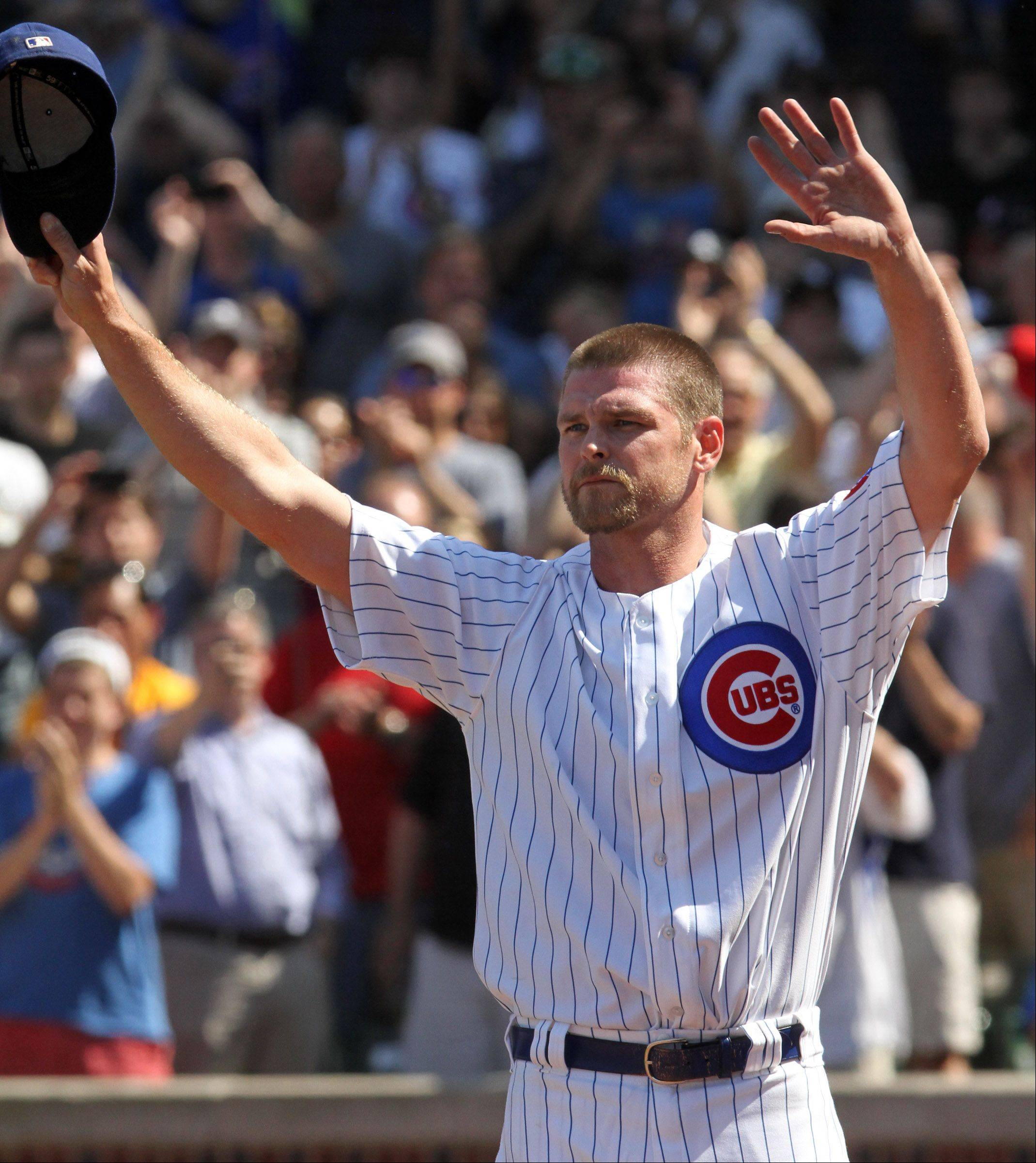 Former Cubs pitcher Kerry Wood, here getting a standing ovation in his last appearance at Wrigley Field on May 18, could be the favorite among contenders seeking Bob Brenly's broadcast job with the Cubs.