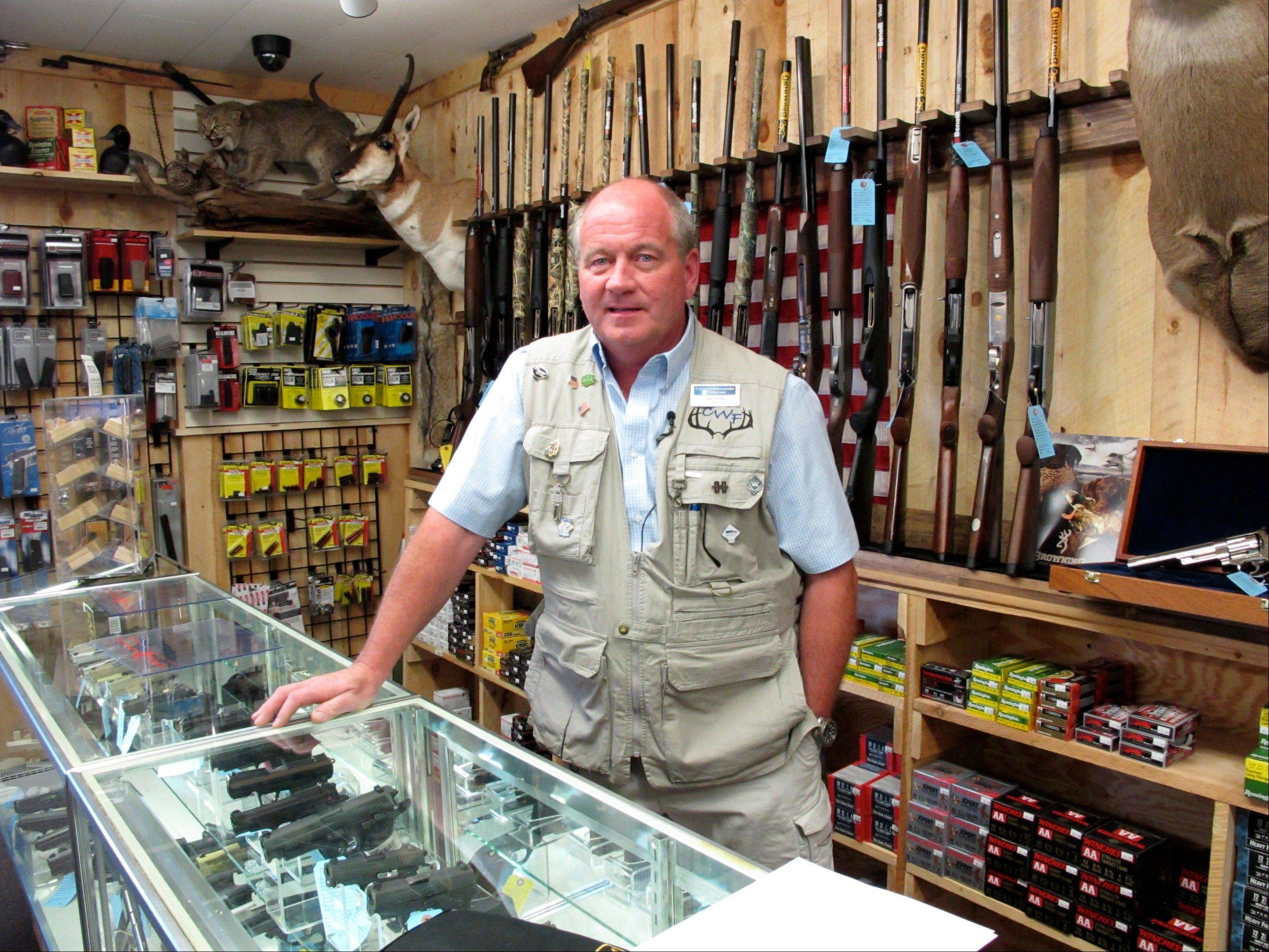 Central Wisconsin Firearms owner Frederick Prehn in his store last August in Wausau, Wis. He says he's had to expand his business to the new location because of increased gun sales.