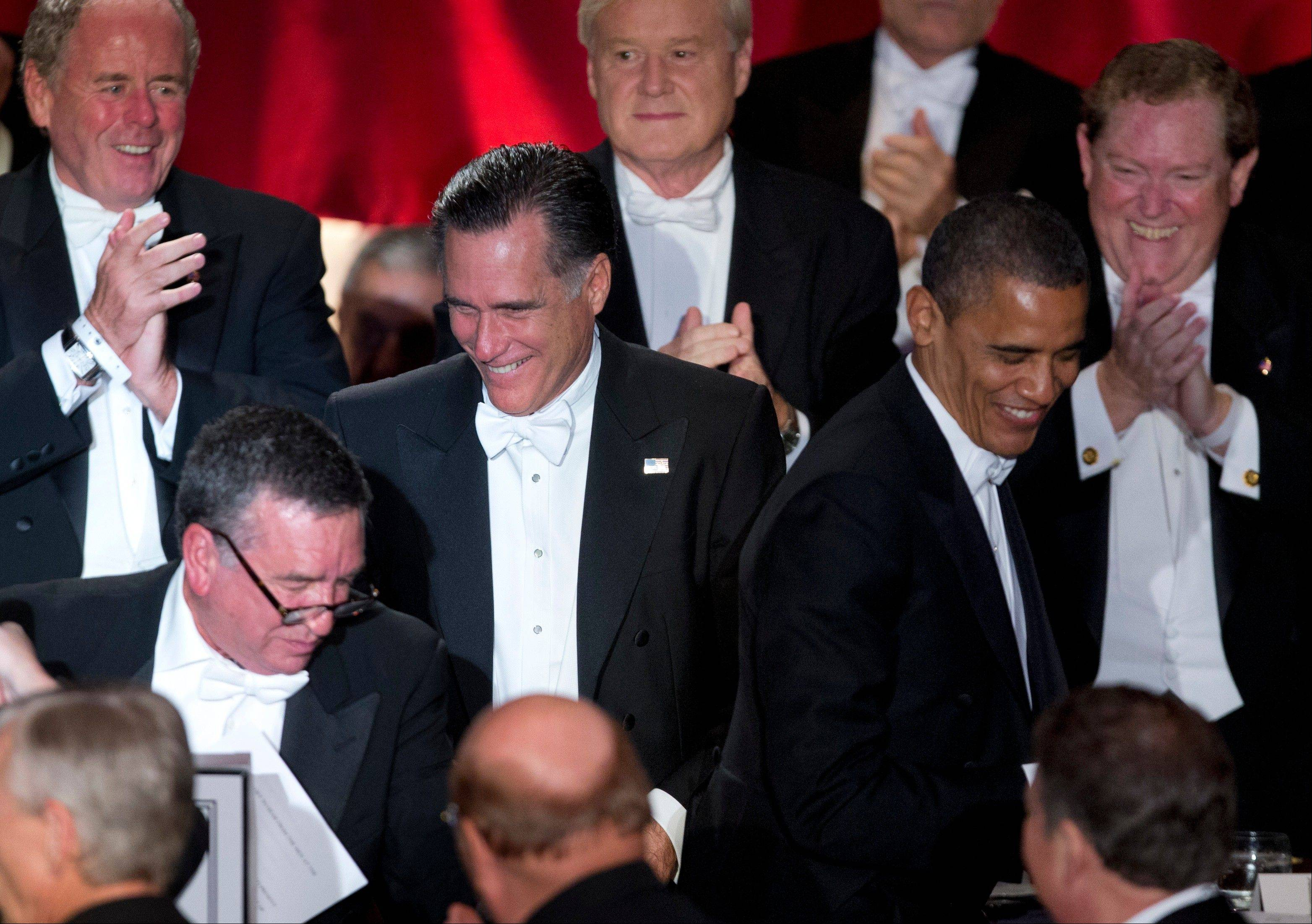 President Barack Obama and Republican presidential candidate, former Massachusetts Gov. Mitt Romney, attend the Archdiocese of New York's 67th Annual Alfred. E. Smith Memorial Foundation Dinner, Thursday at the Waldorf Astoria Hotel in New York.