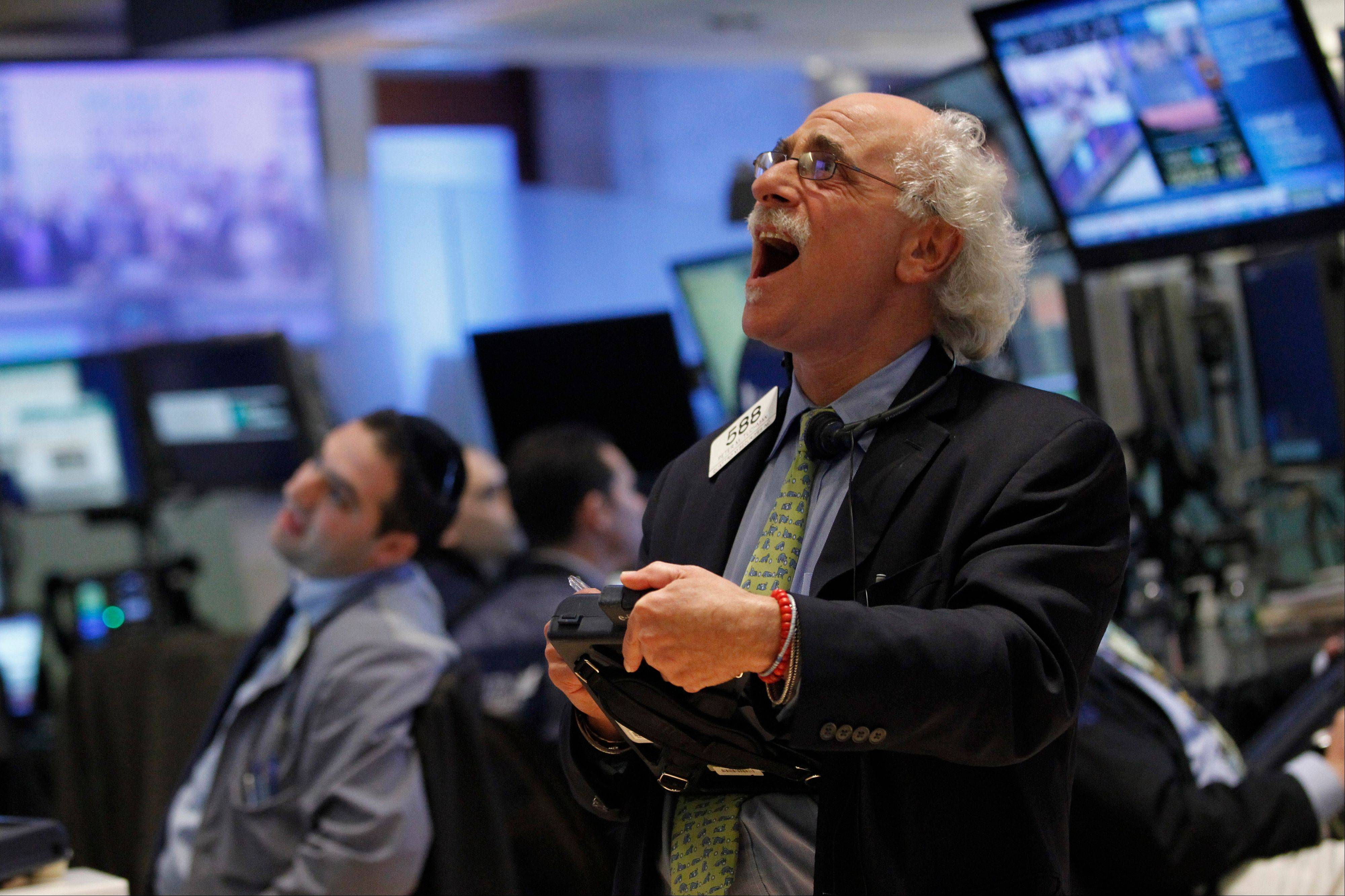 Trader Peter Tuchman reacts as he looks Friday at the numbers during the closing bell on the floor of the New York Stock Exchange.