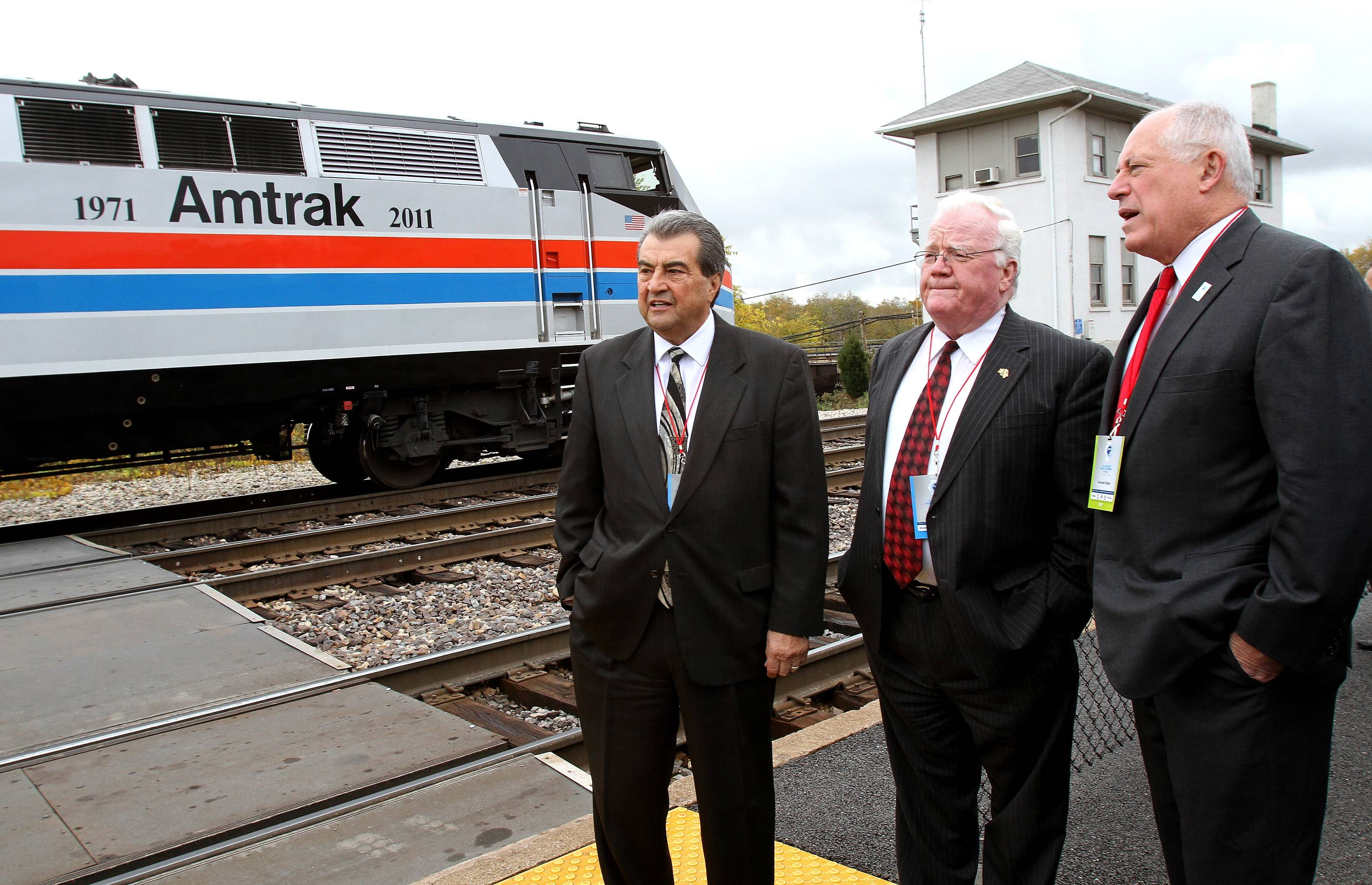 Left to right are Joliet Mayor Tom Giarrante, Larry Walsh, Will County executive and Governor Pat Quinn as they wait to board an Amtrak train.Officials took a high-speed train ride from Joliet to Normal on Friday. A planned high-speed rail route between Chicago and St. Louis will be the first in the midwest.