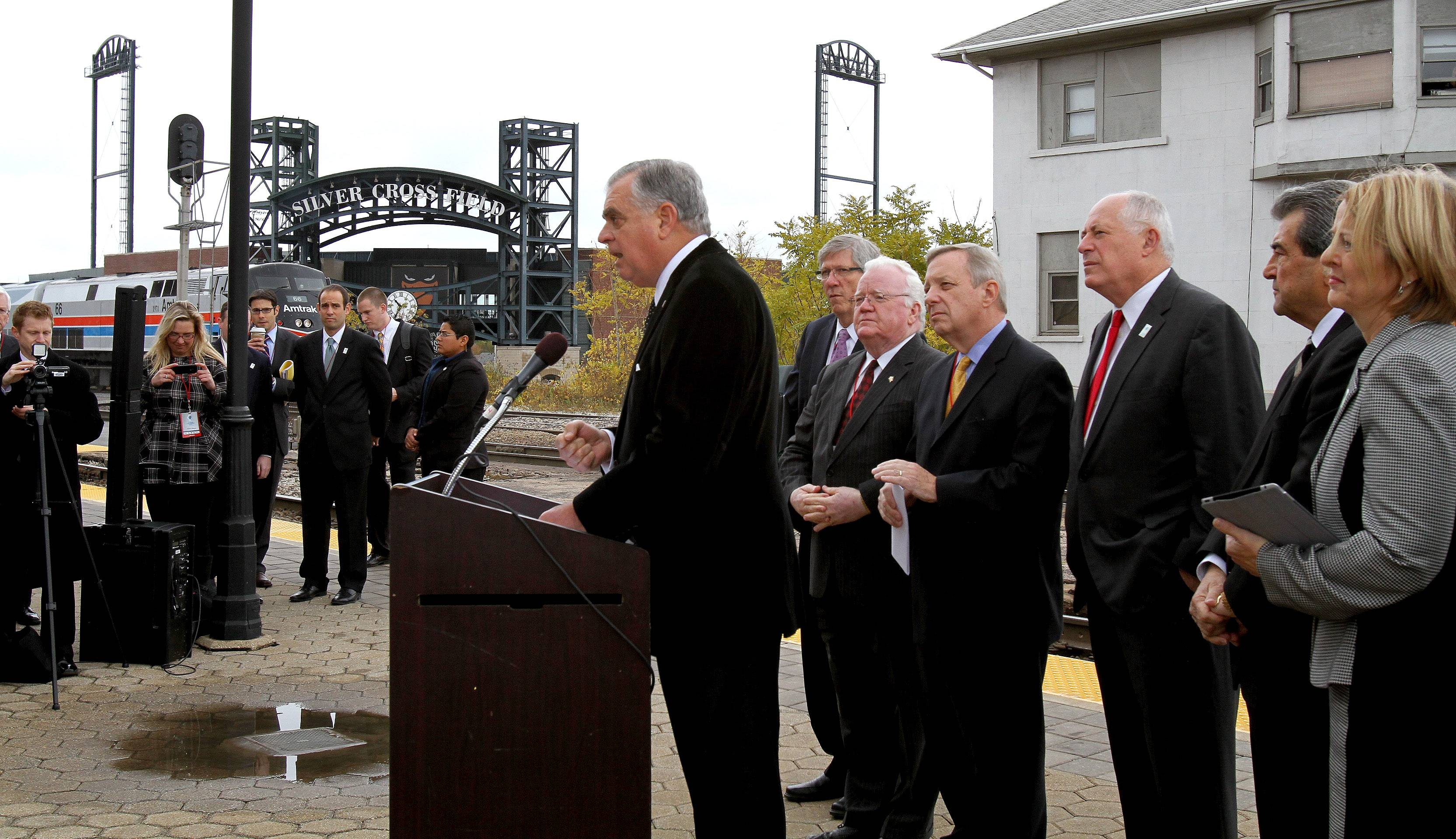 Secretary of Transportation Ray LaHood speaks at a press conference before officials take a high-speed train ride from Joliet to Normal on Friday. A planned high-speed rail route between Chicago and St. Louis will be the first in the midwest.