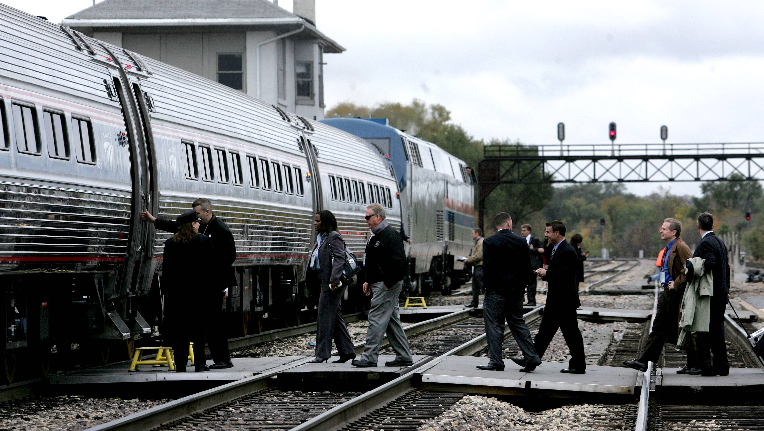 Officials and members of the media board an Amtrak high-speed train for a ride from Joliet to Normal on Friday. A planned high-speed rail route between Chicago and St. Louis will be the first in the midwest.