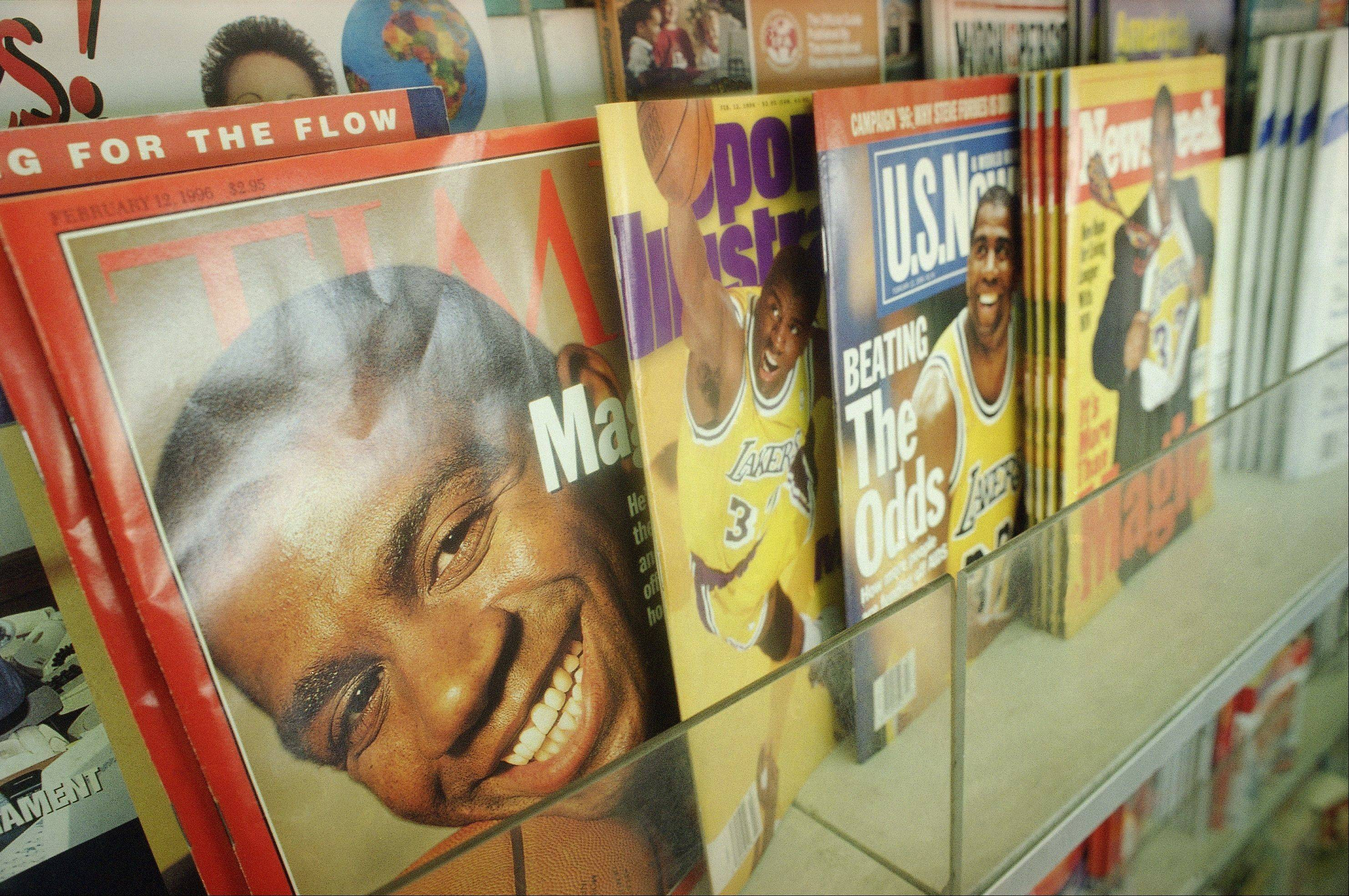 FILE -- In this 1996 photo, Los Angeles Lakers basketball player Magic Johnson adorns the cover of four weekly magazines, from left, Time, Sports Illustrated, U.S. News & World Report and Newsweek in Los Angeles. Newsweek announced Thursday, Oct. 18, 2012 that it will end its print publication after 80 years and shift to an all-digital format in early 2013.