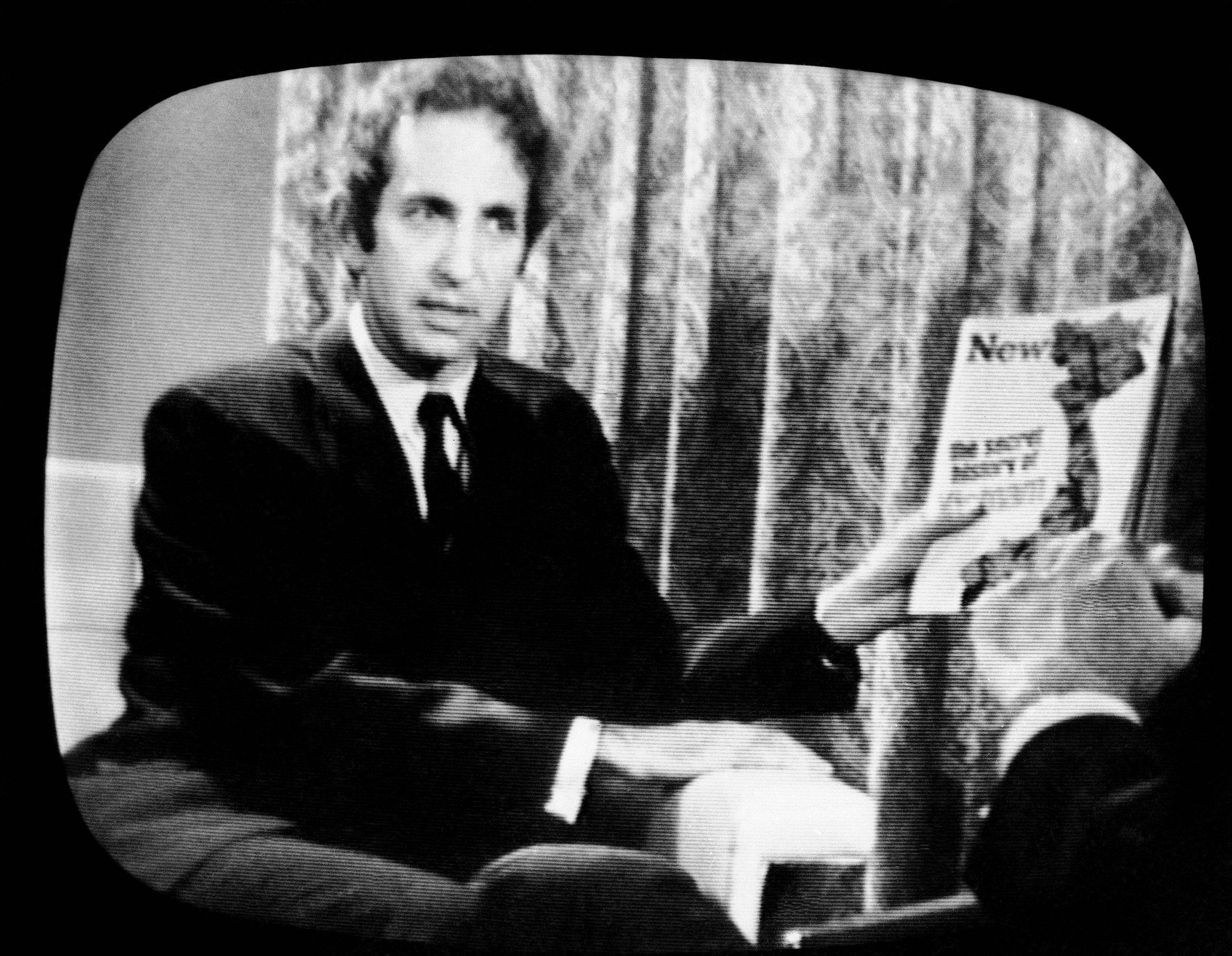 In this 1971 photo, Daniel Ellsberg, holds a copy of Newsweek on CBS television program.