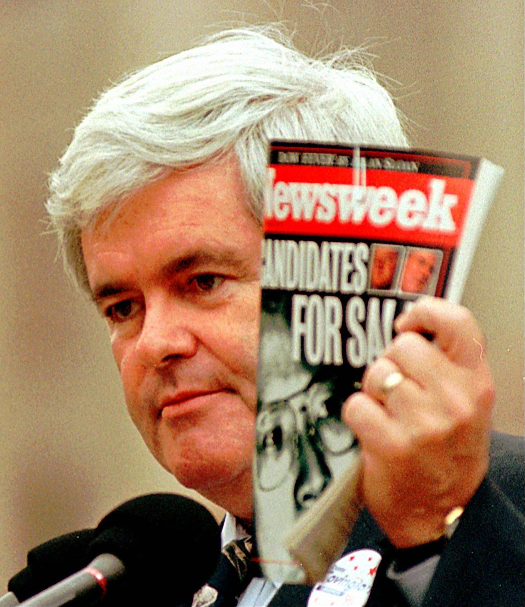 In this 1996 photo, House Speaker Newt Gingrich, R-Ga., holds a copy of Newsweek Magazine and makes comments about President Clinton and the Democratic Party in Jackson, Miss.