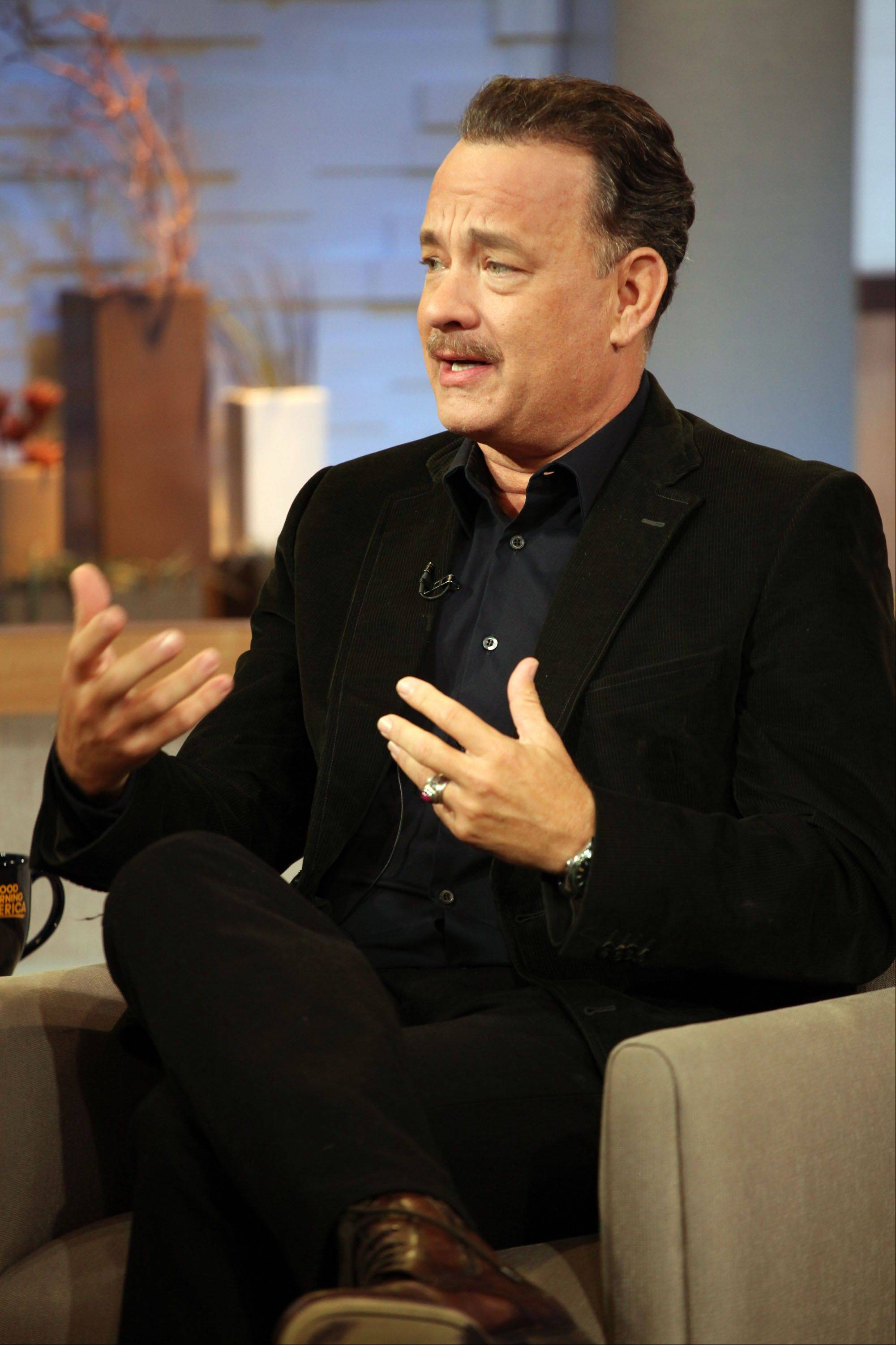 "Actor Tom Hanks let slip a swear word during a live appearance on ""Good Morning America"" Friday morning."