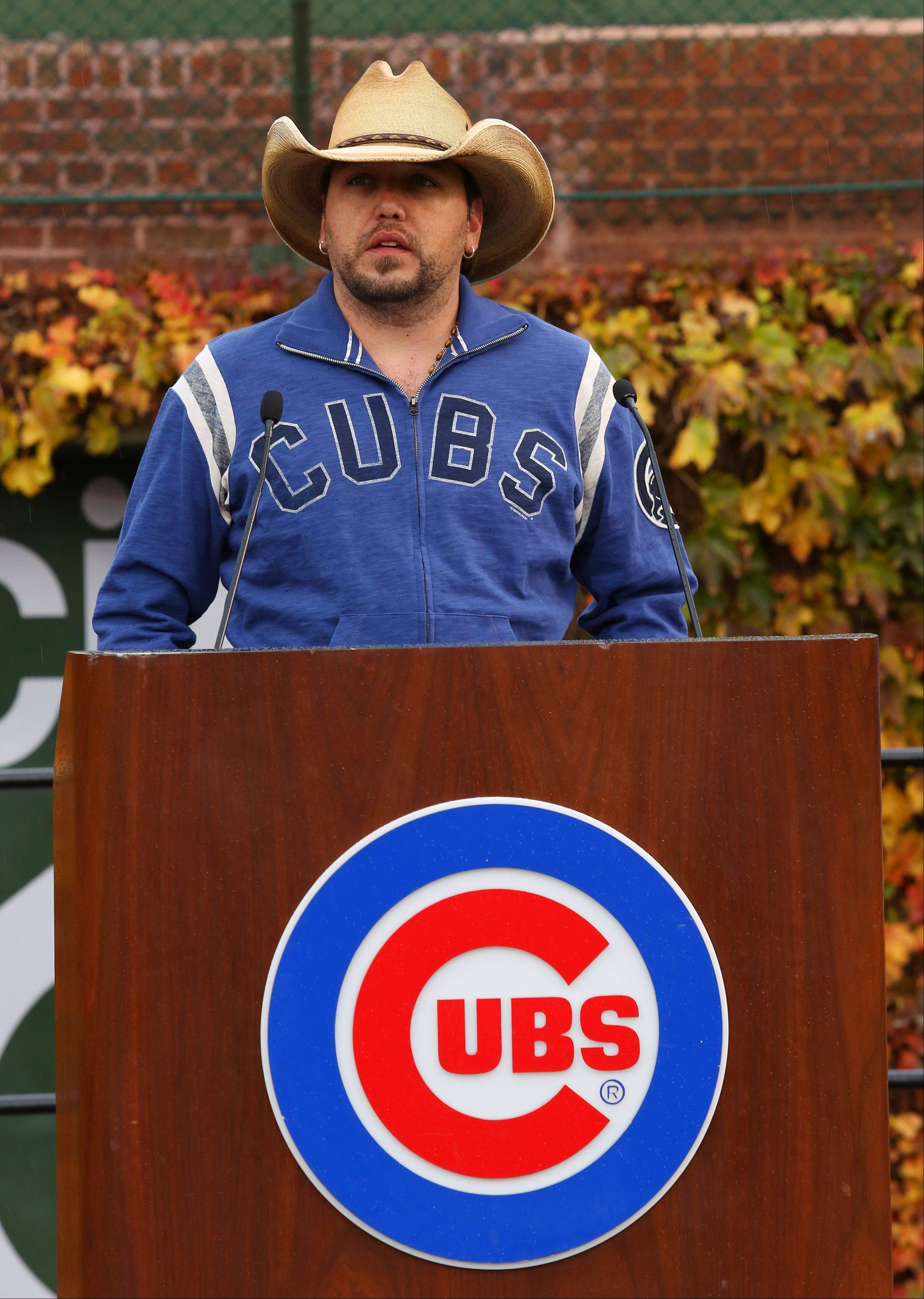 Country singer Jason Aldean speaks during a news conference at Wrigley Field to announce his 2013 Night Train Tour will be coming to Chicago.