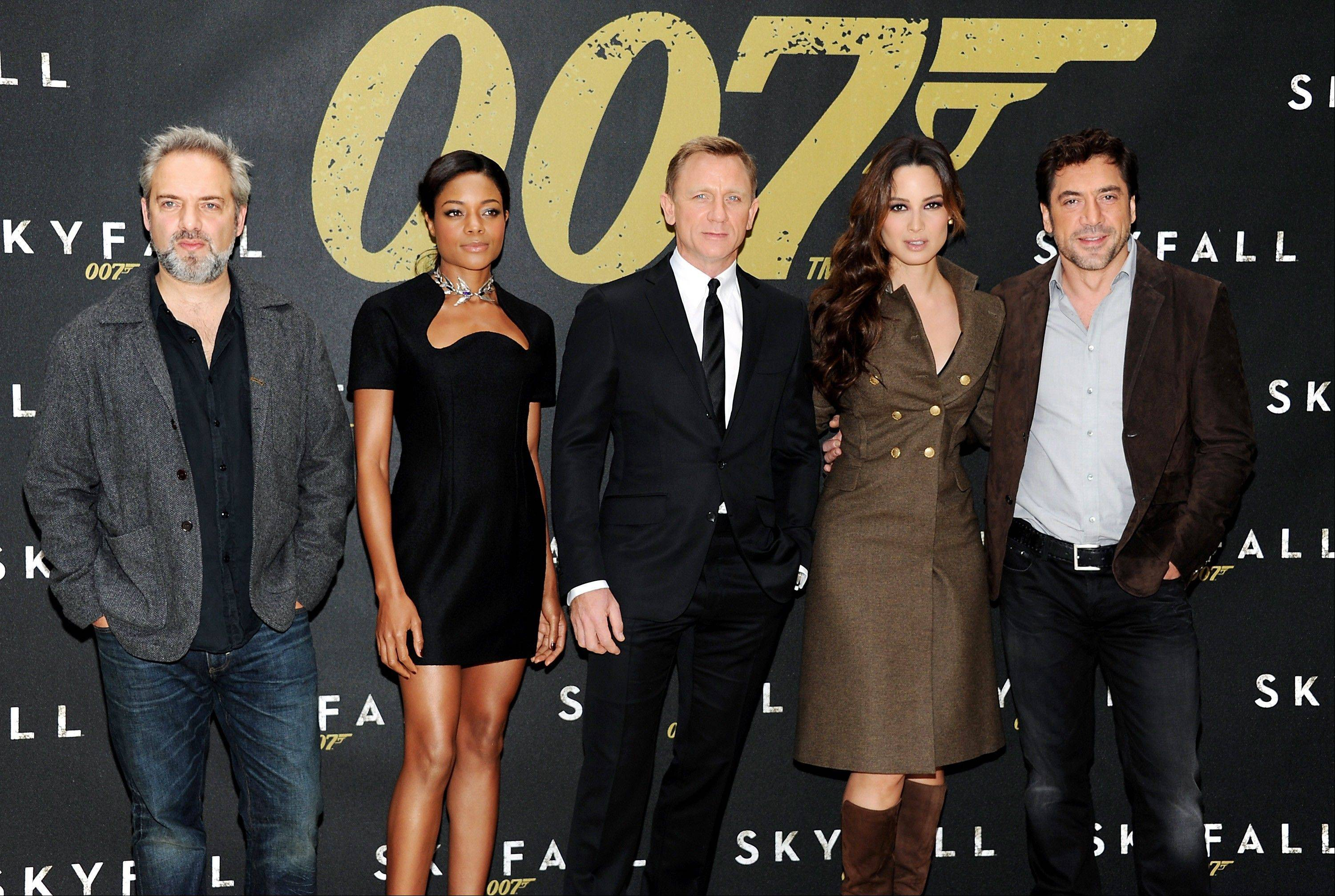 "Director Sam Mendes, left, and actors Naomie Harris, Daniel Craig, Berenice Marlohe and Javier Bardem during a photo call for the new James Bond film ""Skyfall"" in New York Monday."