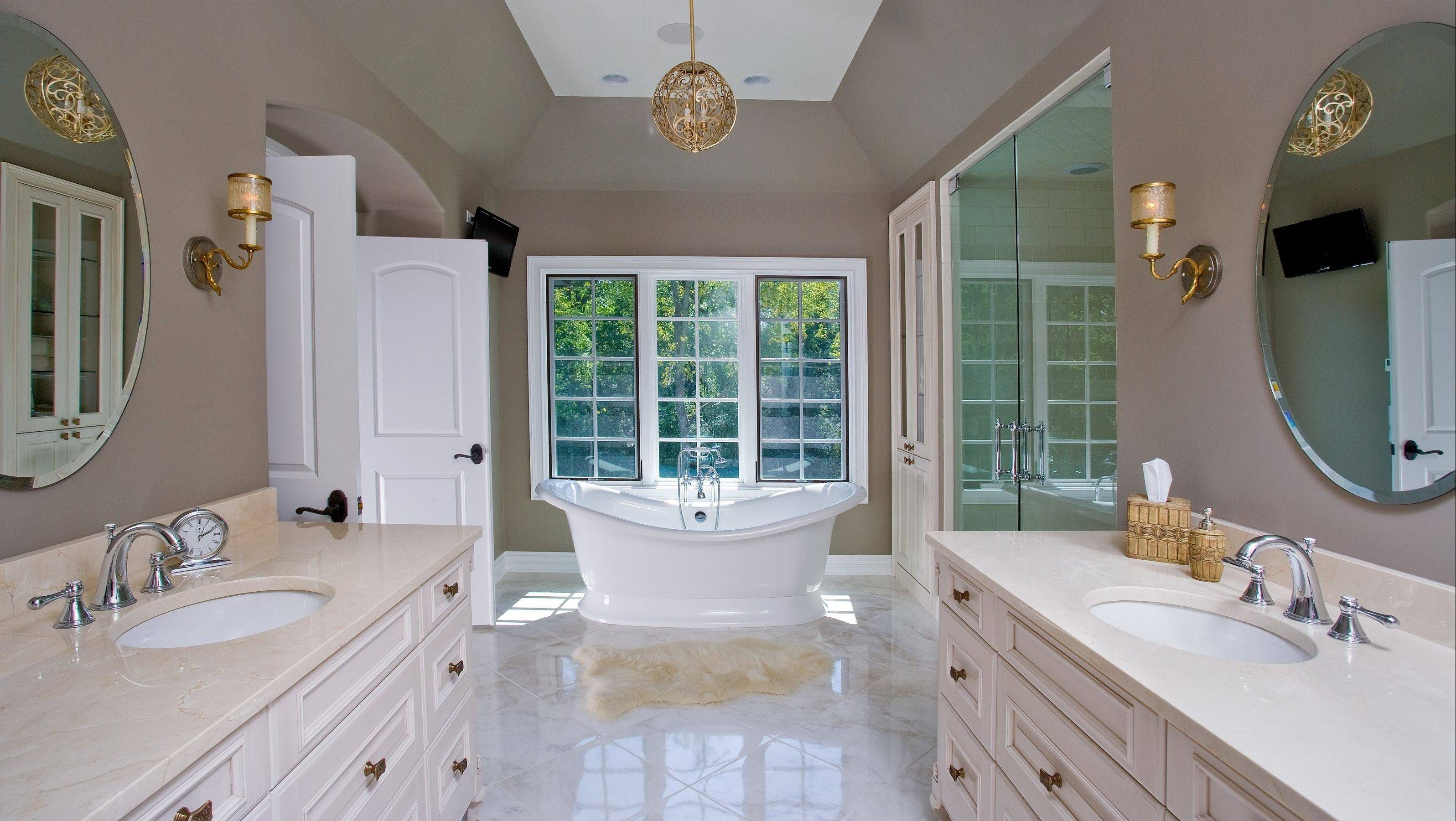 The master bathroom is spacious with a Zen bath and large windows allowing a great view of nature.