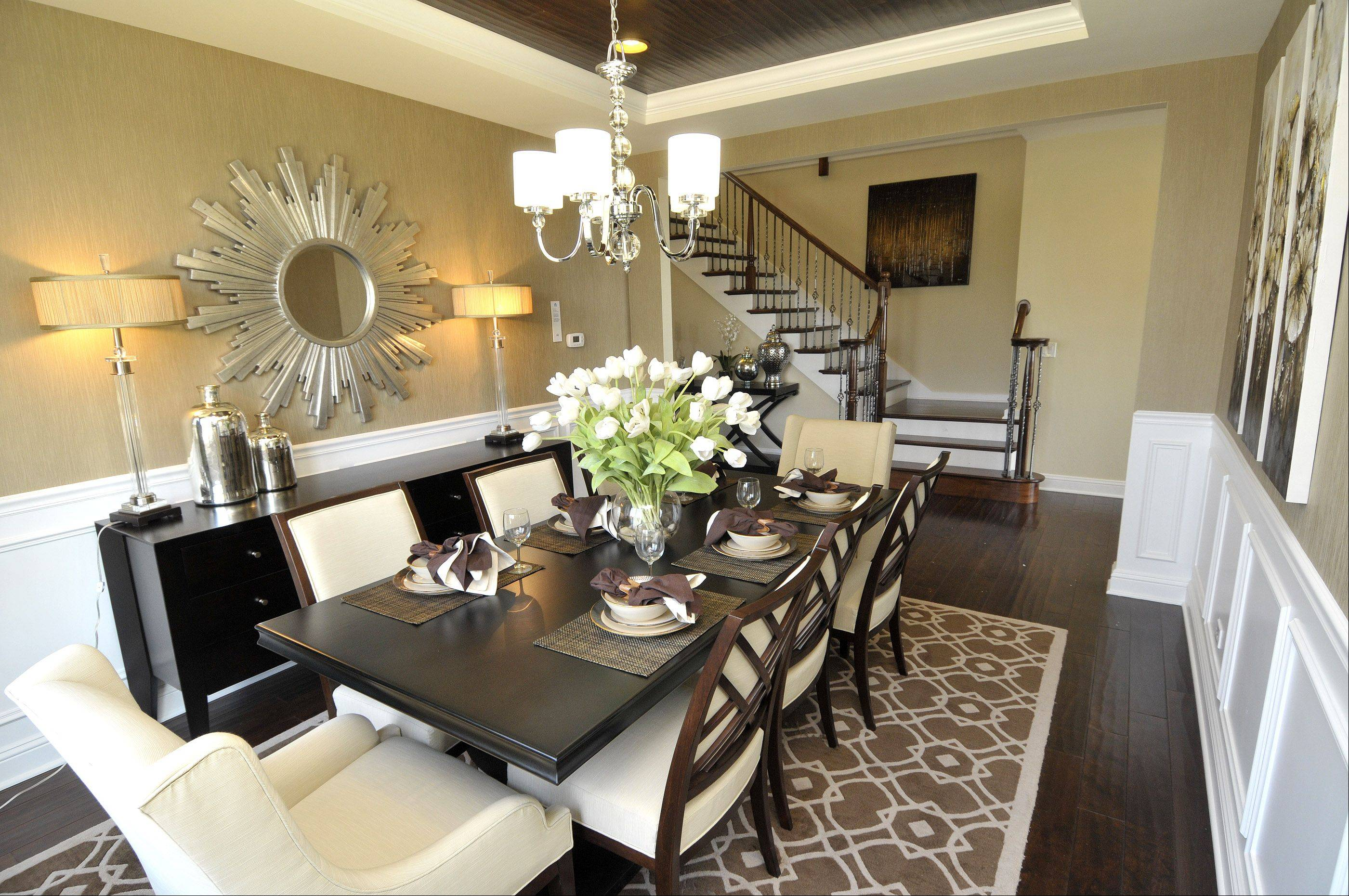 A neutral palette of white, creams and browns with silver accents creates a calm ambience in the Naples model at the Savoy Club community in Burr Ridge.