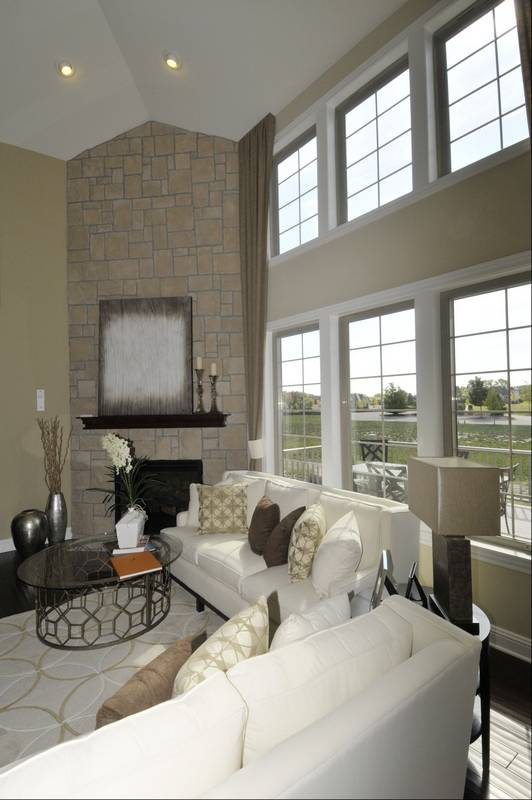In The Family Room A Corner Stone Fireplace And A Wall Of Windows Provide The