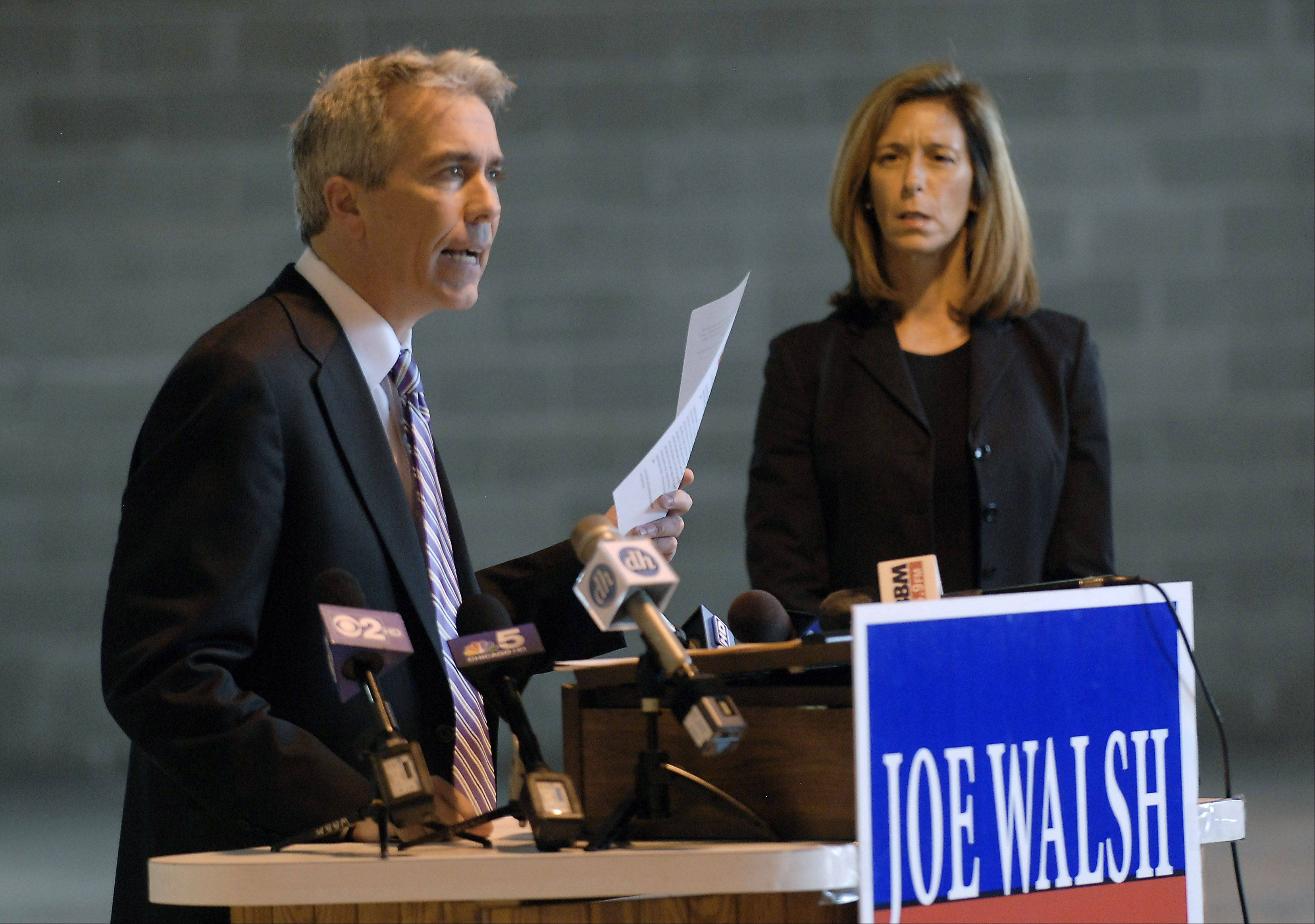 Congressman Joe Walsh reaffirms his pro-life stance without exception but notes some procedures may be medically necessary to save the life of the mother. His wife Helene Walsh looks on.