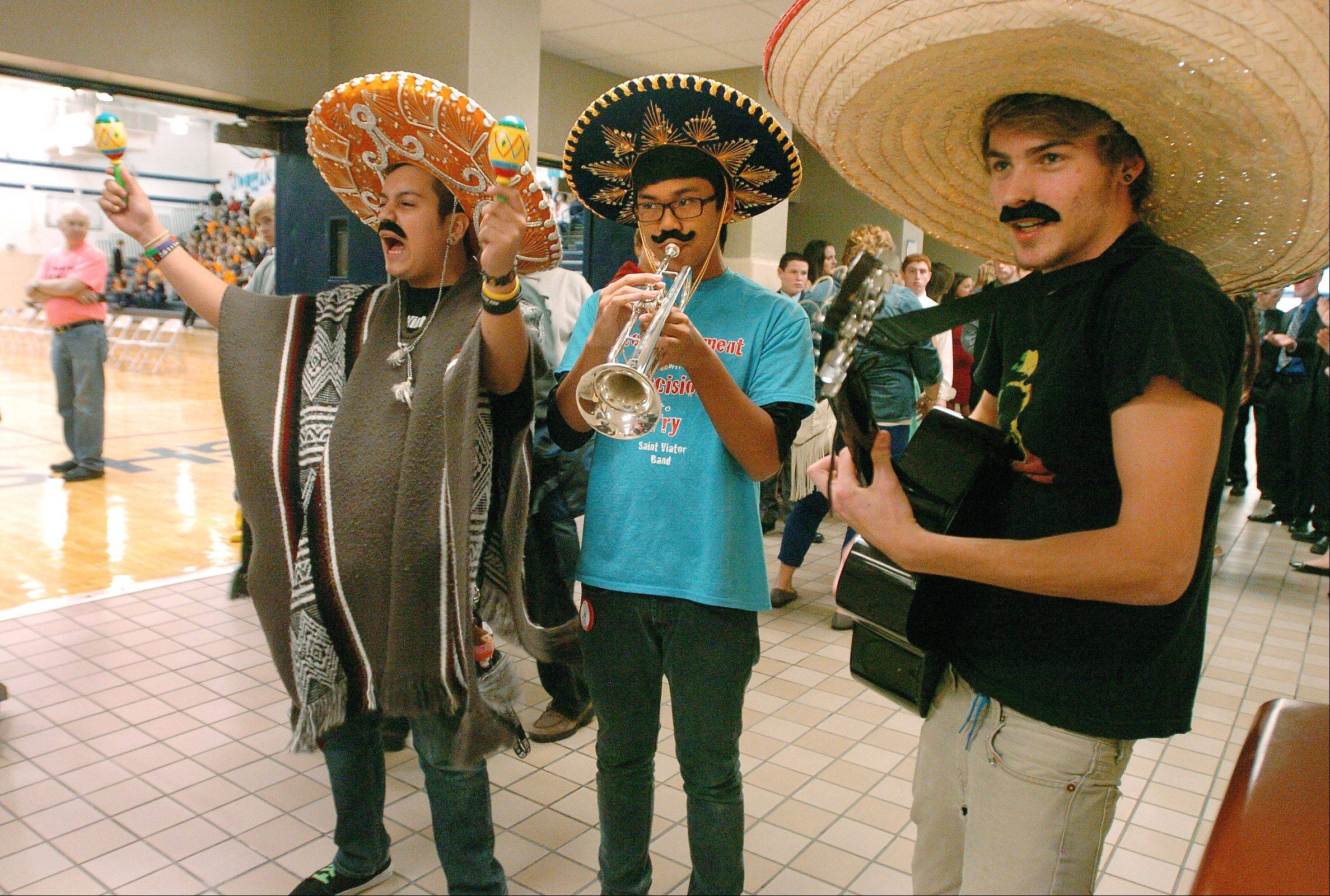 From left, Sergio Hernandez, Nathan Abay and James Pickering form an impromptu Mariachi band during St. Viator's Homecoming Pep Rally.