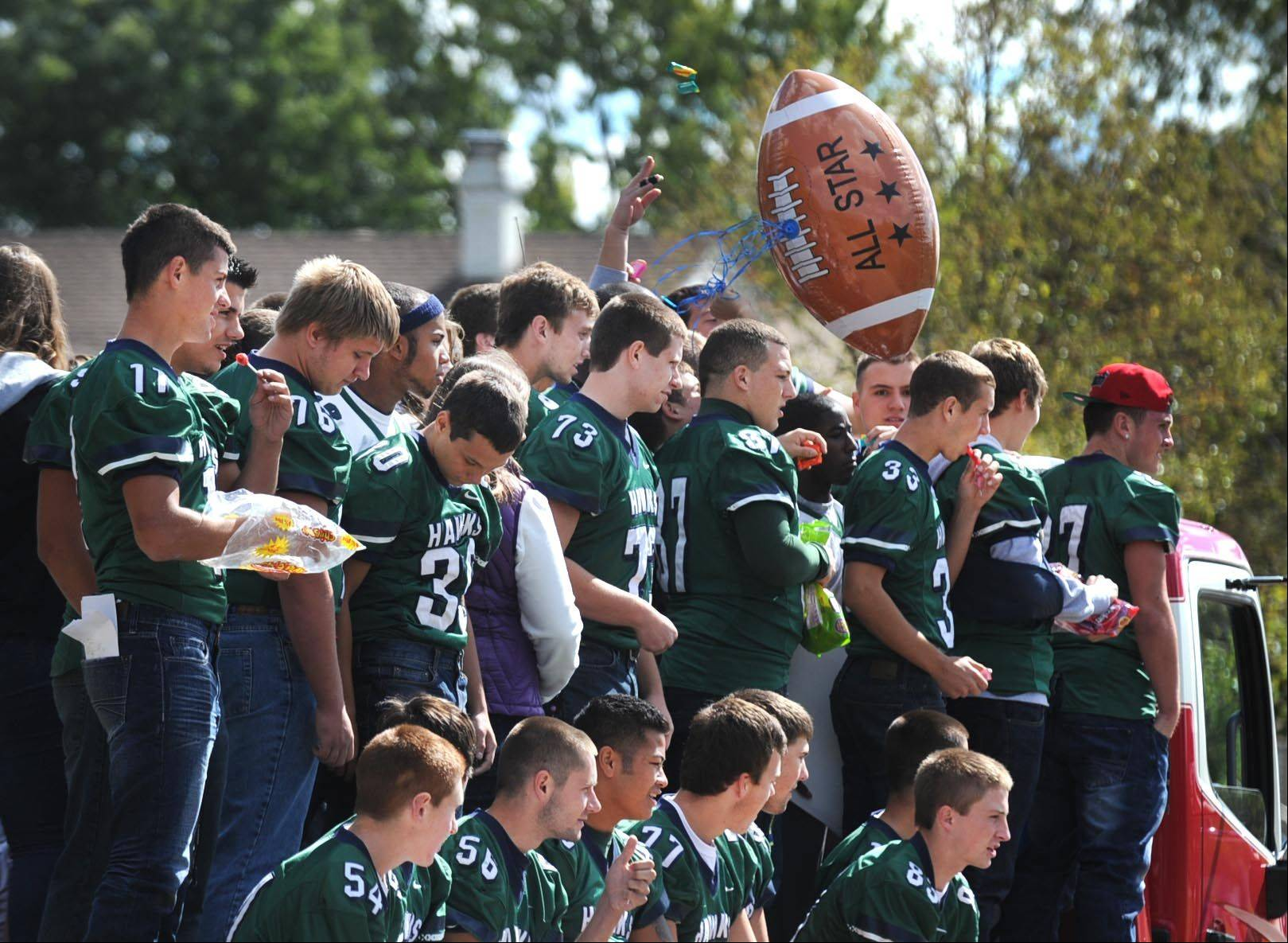 The Bartlett High School football team bounces a balloon around on their float during their Homecoming parade.