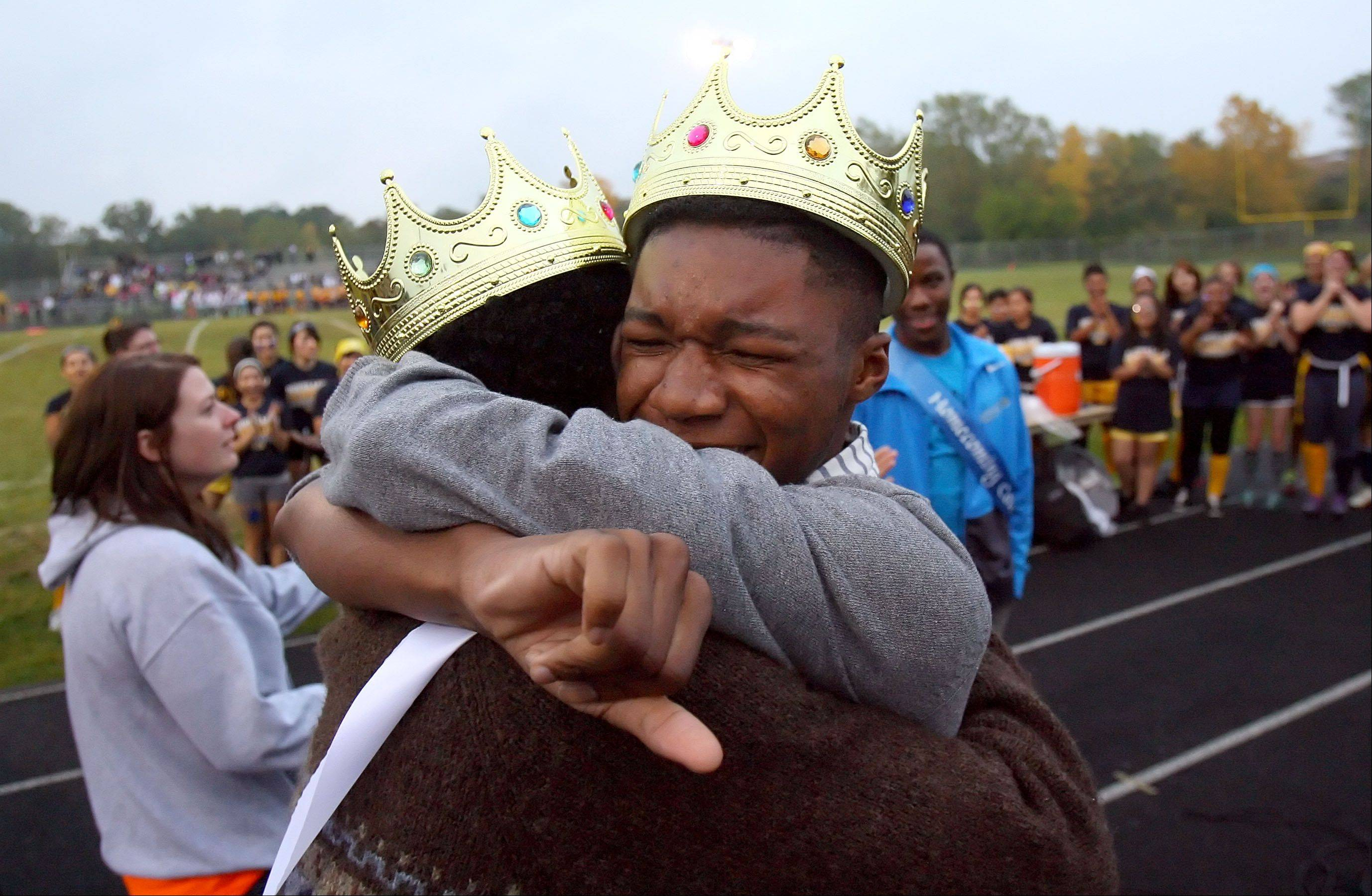 Bryant Jenkins, left, and Bougest Sutton hug after being crowned homecoming royalty during halftime of the Powder-Puff Extravaganza at Round Lake High School.