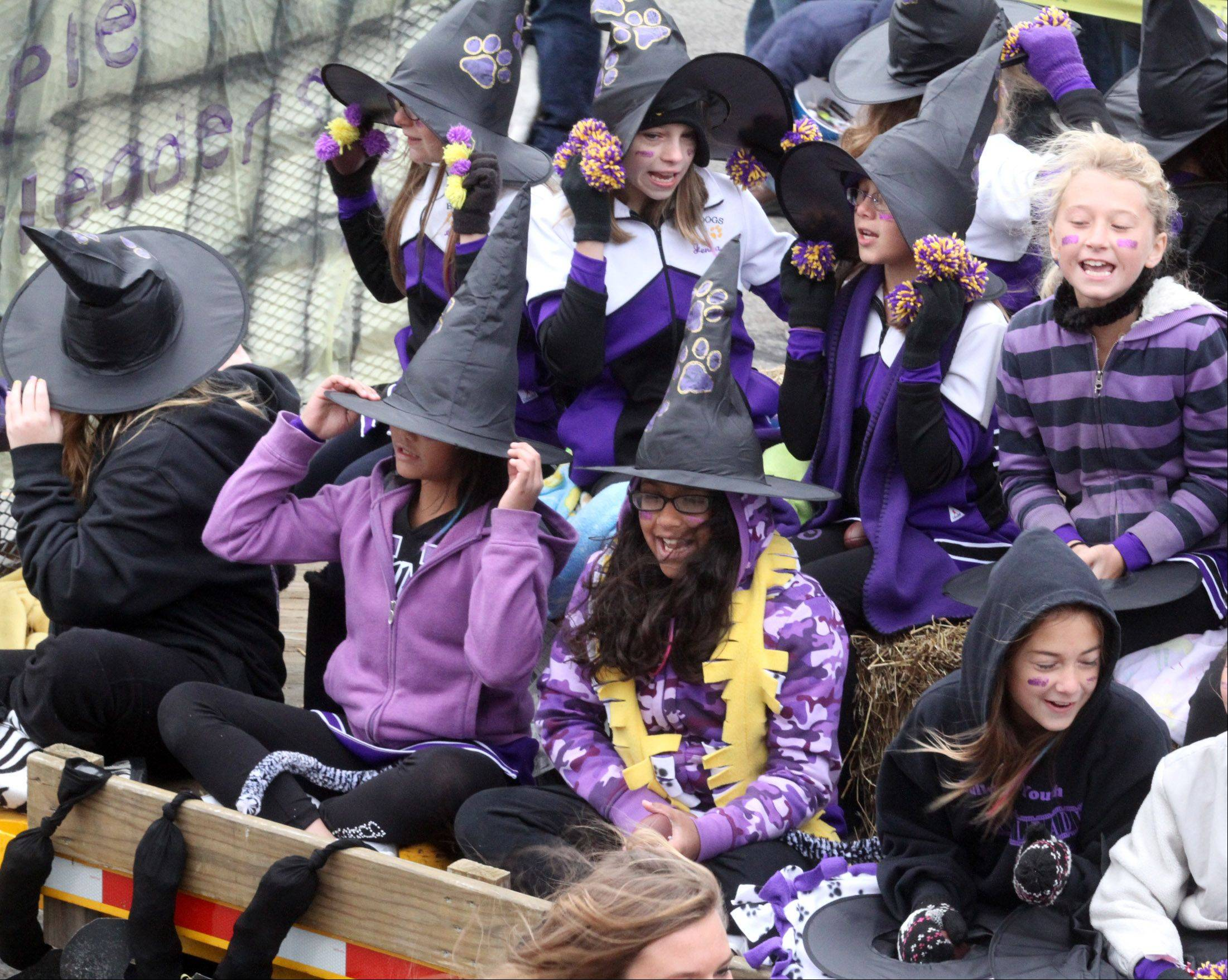 Bulldogs cheerleaders hold on to their witch hat during Wauconda High School's Homecoming parade .