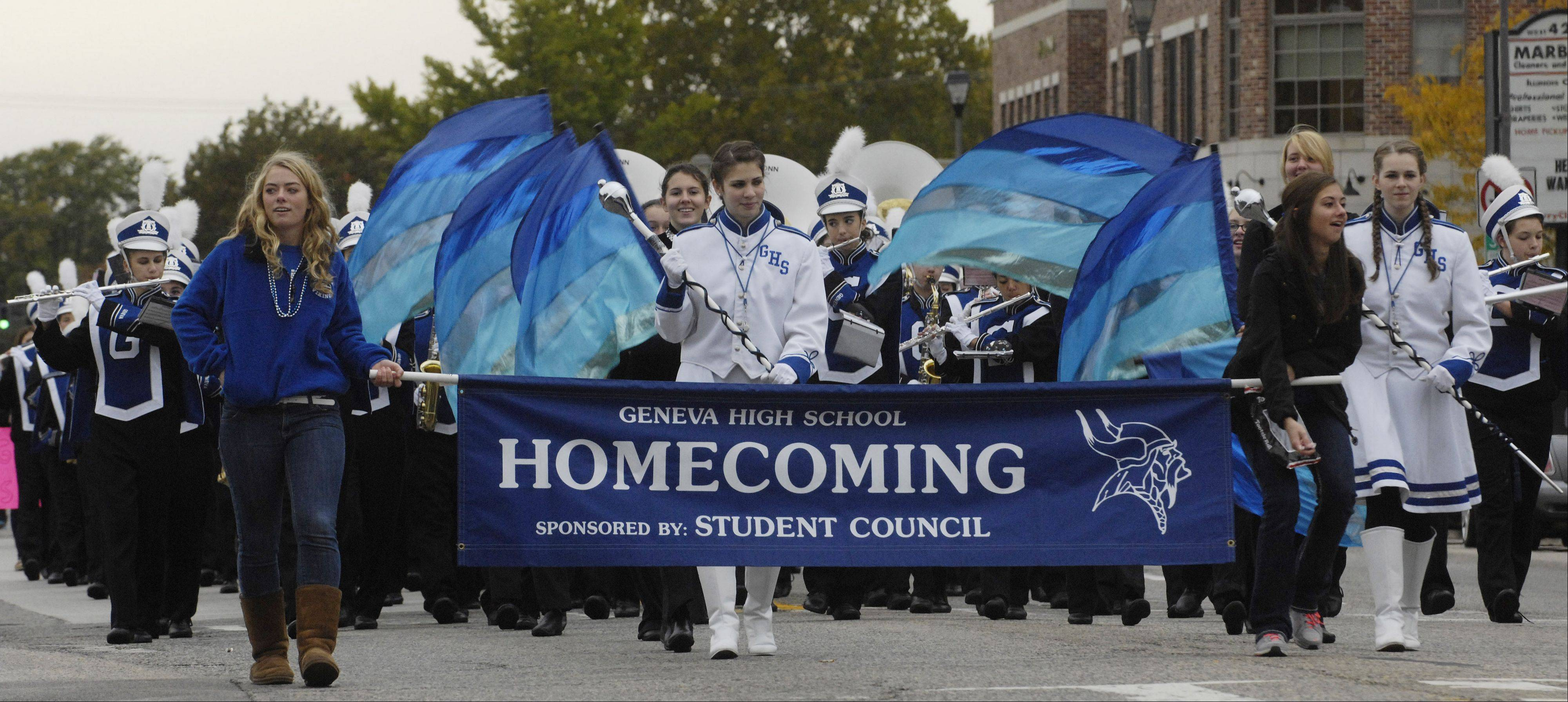 Geneva High School's Homecoming parade, led by the student council and the band, moves eastward on State Street.