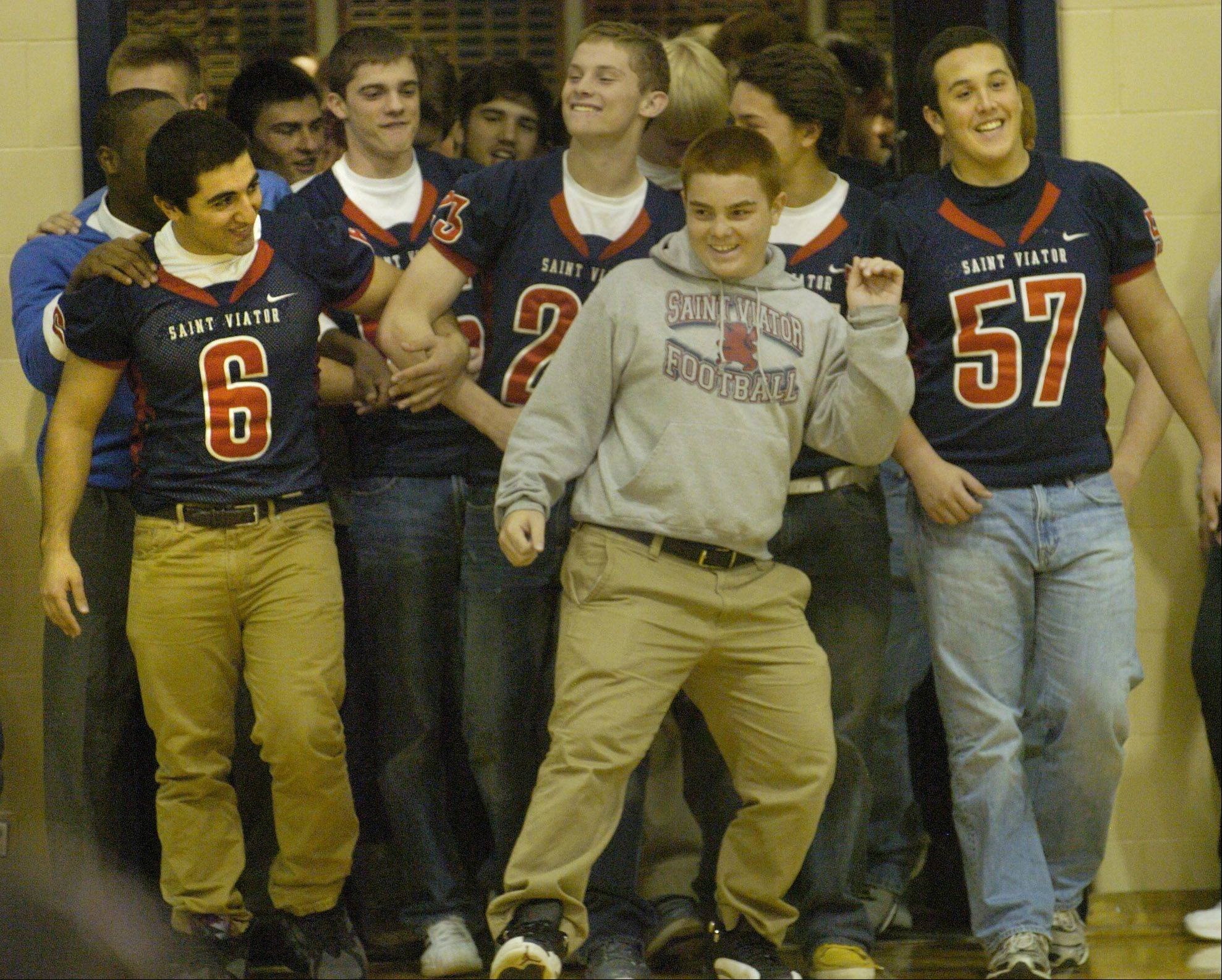 The varsity football team is announced during St. Viator's Homecoming Pep Rally.